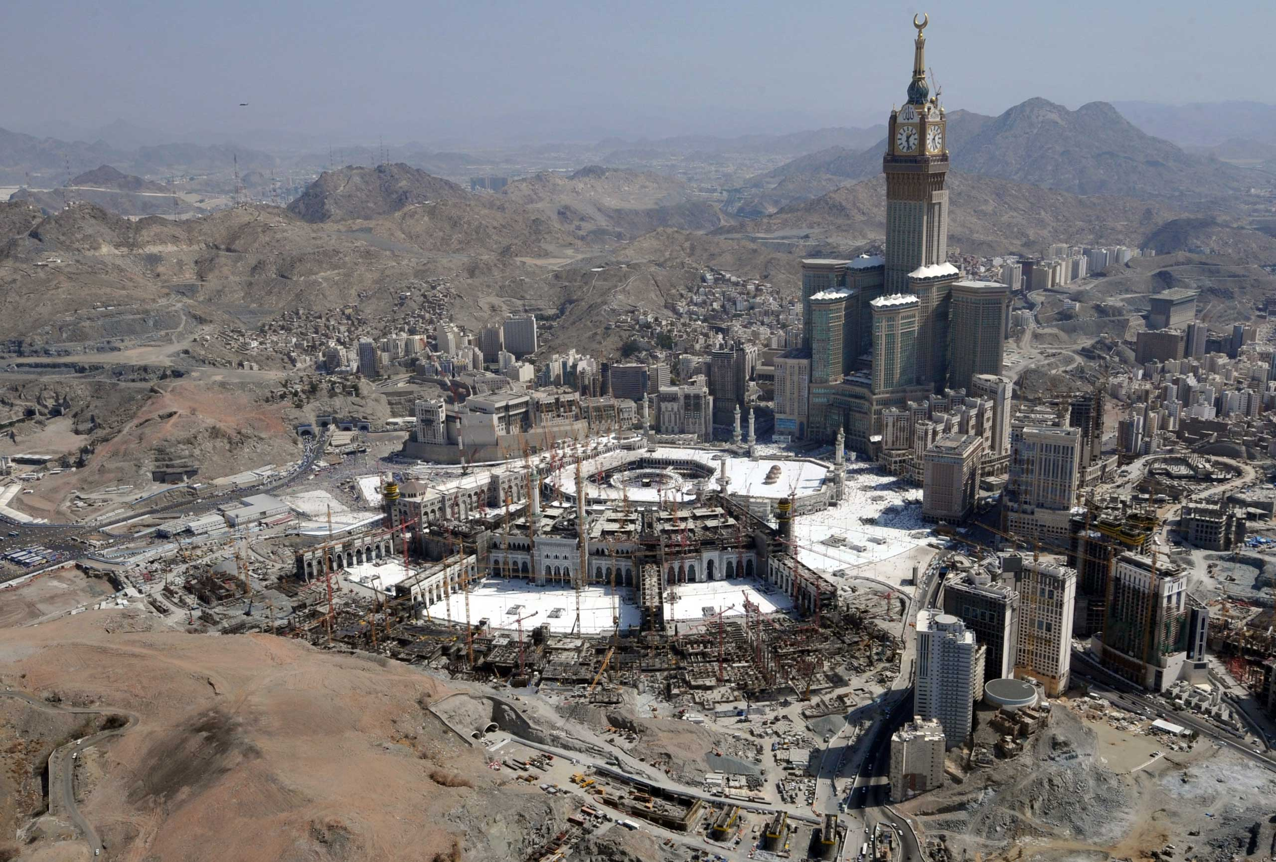 An aerial view shows the Clock Tower, the Grand Mosque, and surrounding constructions sites in the holy city of Mecca, in 2013.