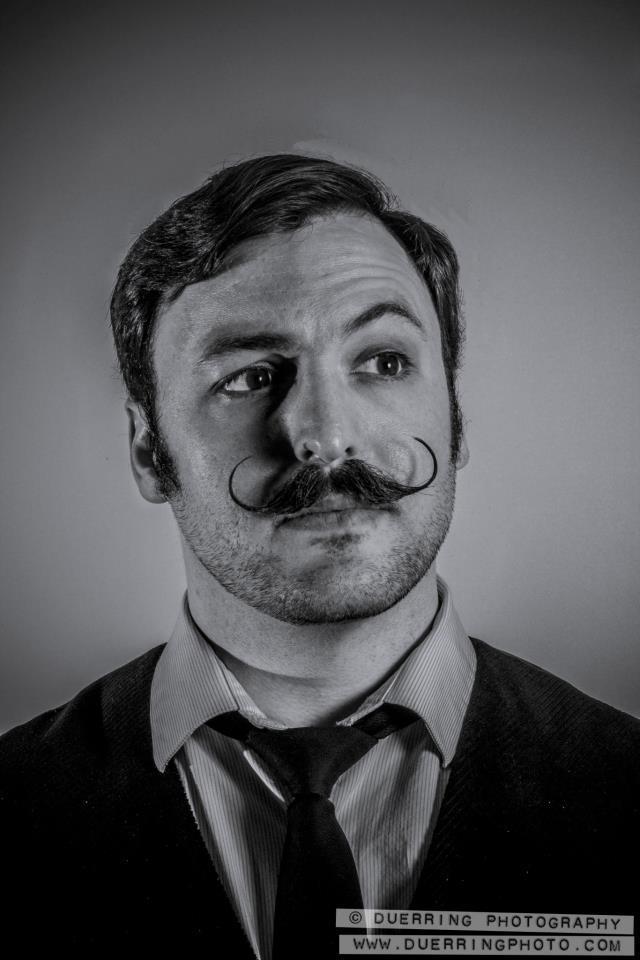 Causgrove, a proud handlebar mustache-wearer.