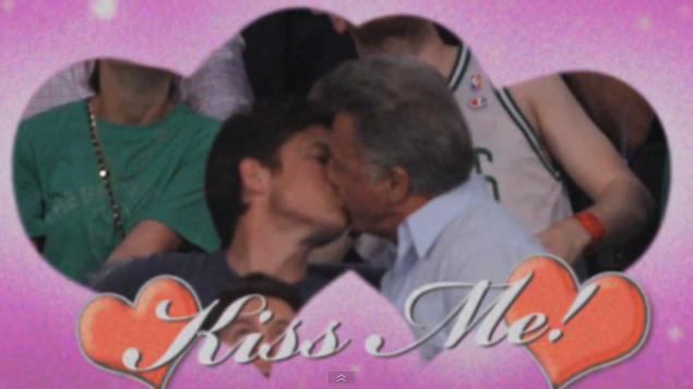 Dustin Hoffman and Jason Bateman kiss on camera at a Lakers game
