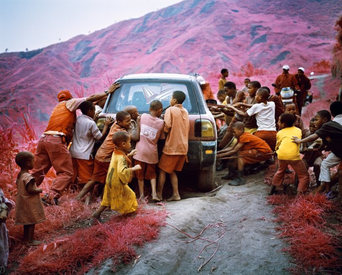 """From the series """"Infra."""" South Kivu, eastern Democratic Republic of Congo, 2011. A car is hauled from a cliff precipice by Hutus on the Numbi road."""