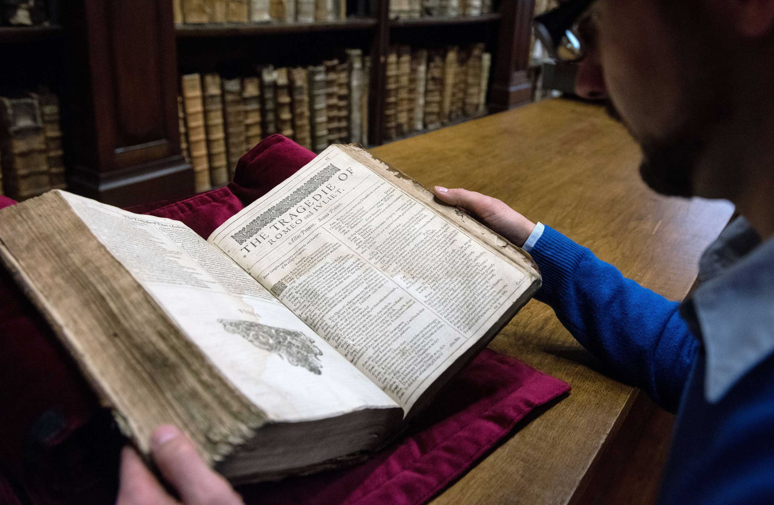 Remy Cordonnier, librarian in the northern town of Saint-Omer, near Calais carefully shows an example of a valuable Shakespeare  First Folio , a collection of some of his plays, dating from 1623.