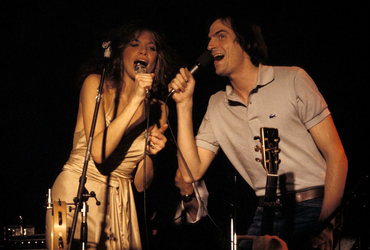 Carly Simon and James Taylor performing