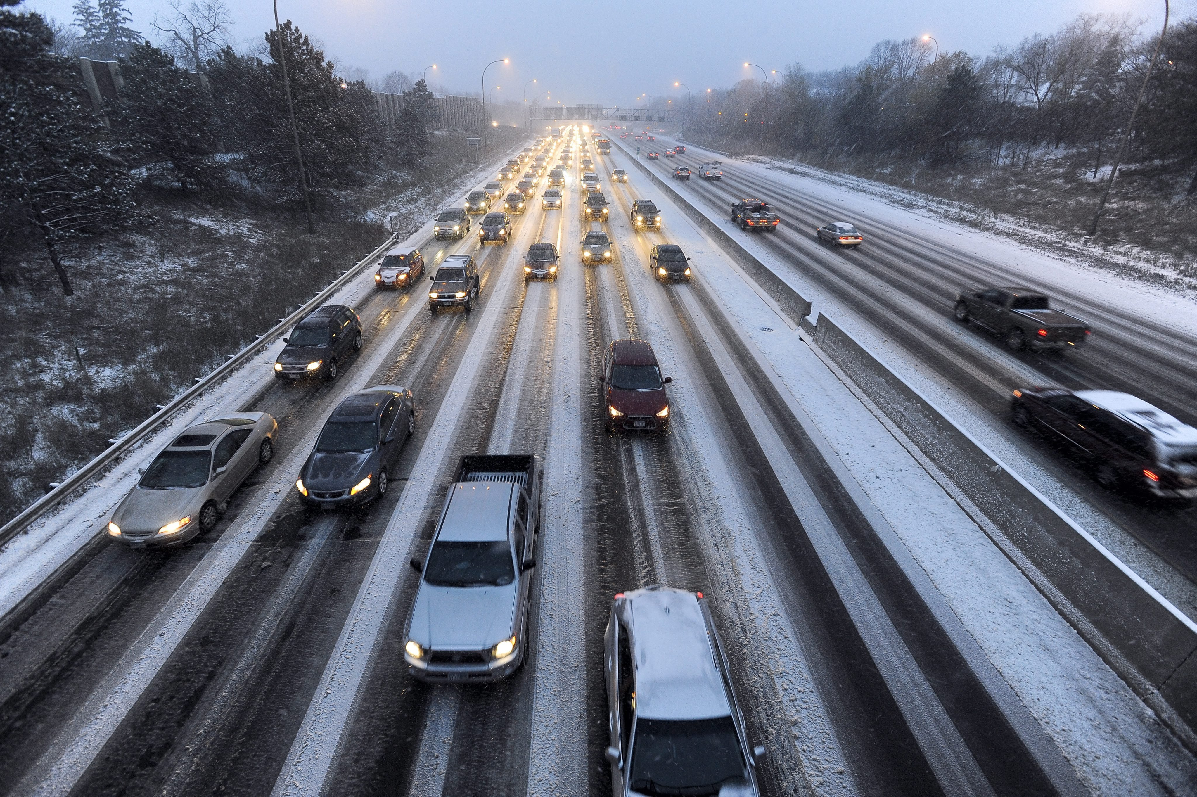 Traffic on Interstate 35 slows to a crawl during the season's first snowstorm in Minneapolis on Nov. 10, 2014.