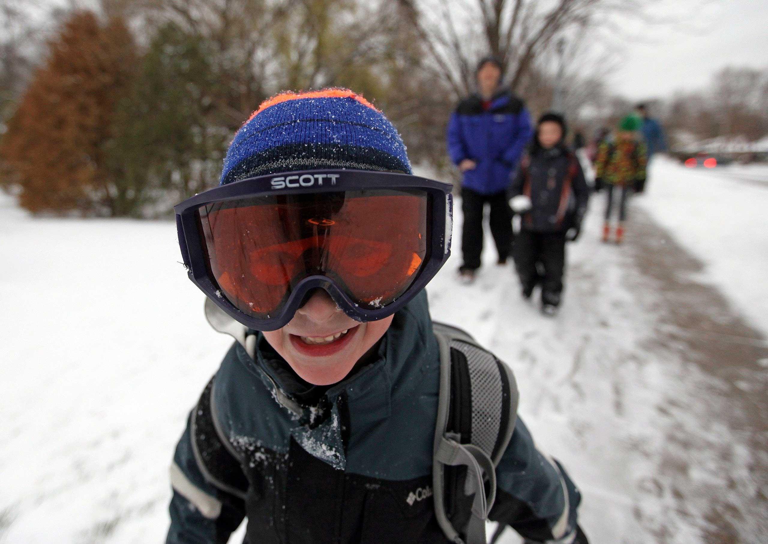 Jacob Rowell wears ski googles as he walks to school in Minneapolis, Nov. 10, 2014.