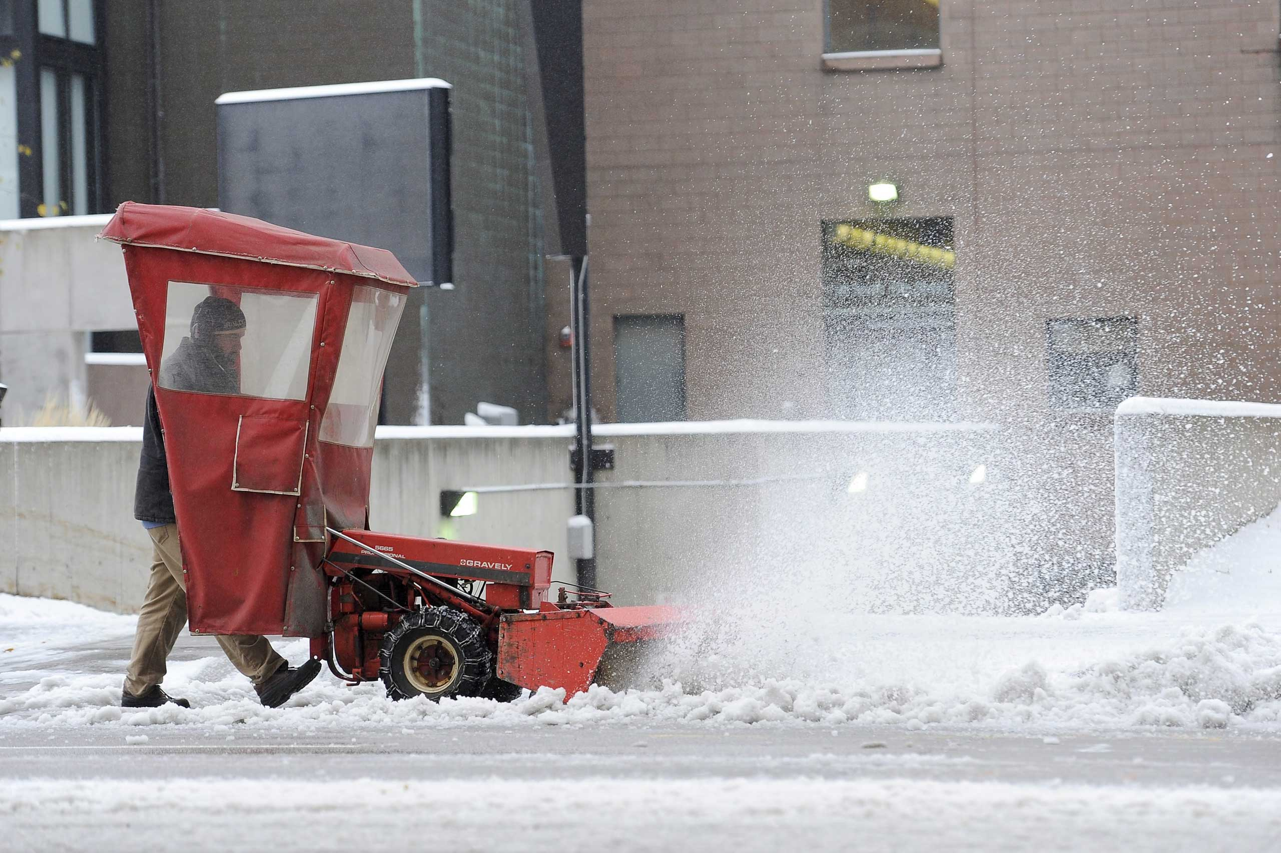 City workers clear the snow during the season's first snowstorm in Minneapolis, on Nov. 10, 2014.