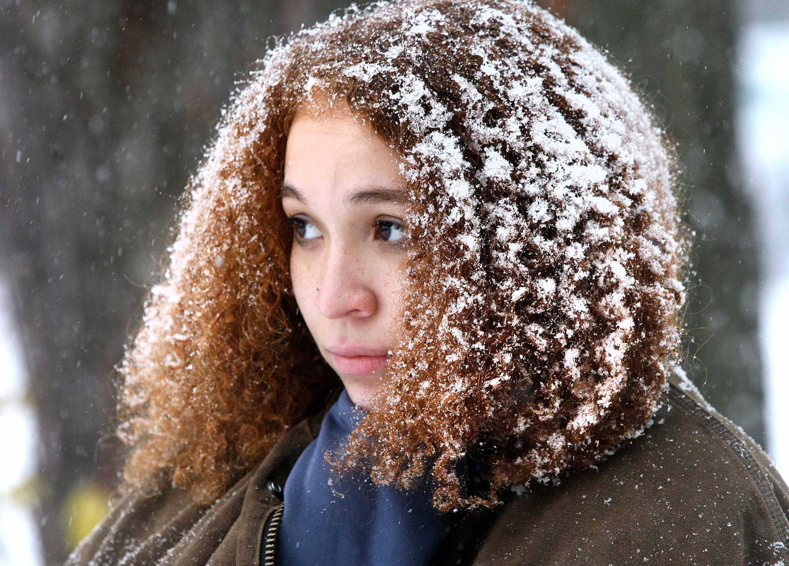 Perry Stephens waits to move her car after multiple collisions occurred at an intersection, following a snowfall in Duluth, Minn. on Nov. 10, 2014.