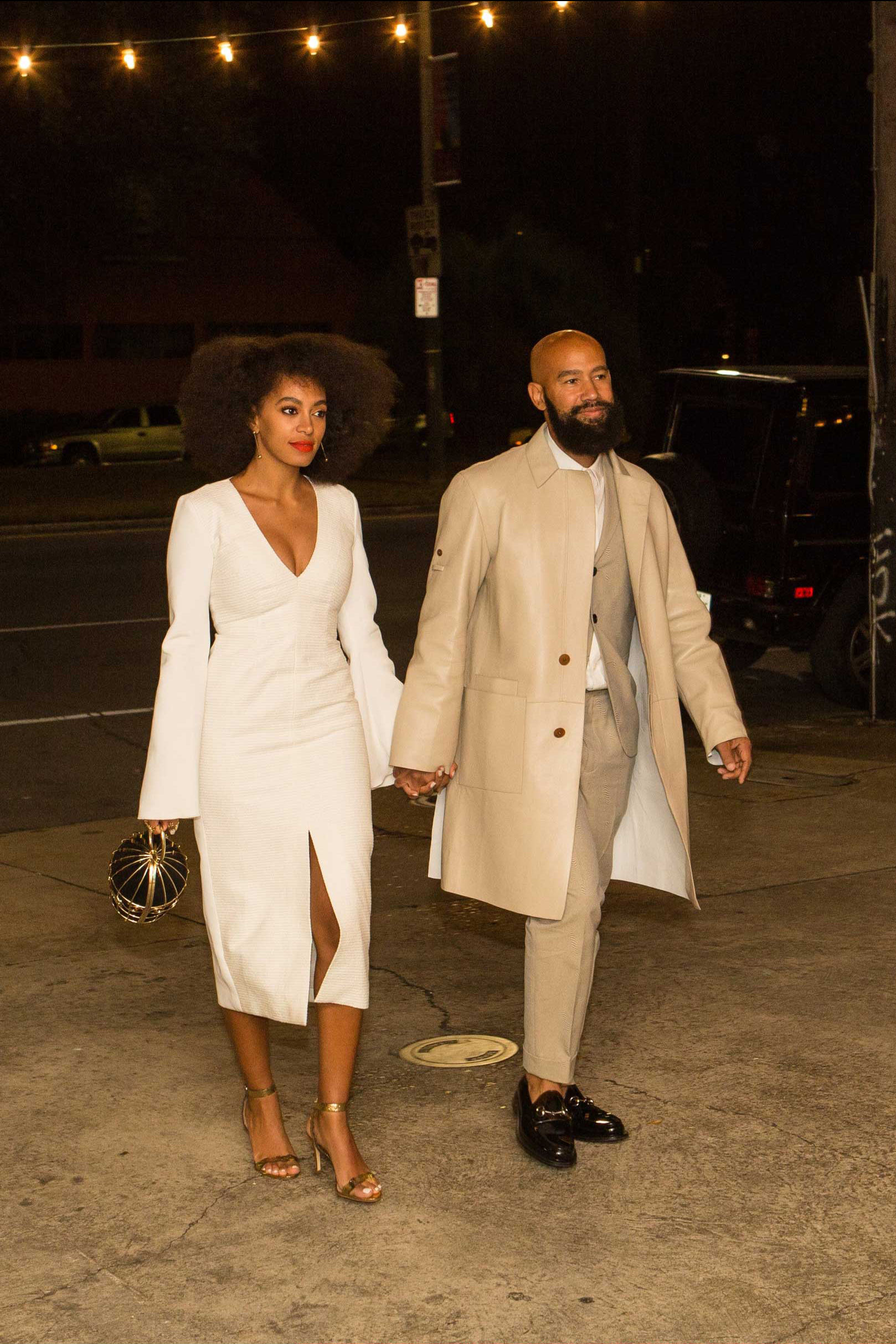 Musician Solange Knowles (L) and her fiancee, music video director Alan Ferguson, are seen outside the Indywood Cinema in New Orleans on Nov. 14, 2014.