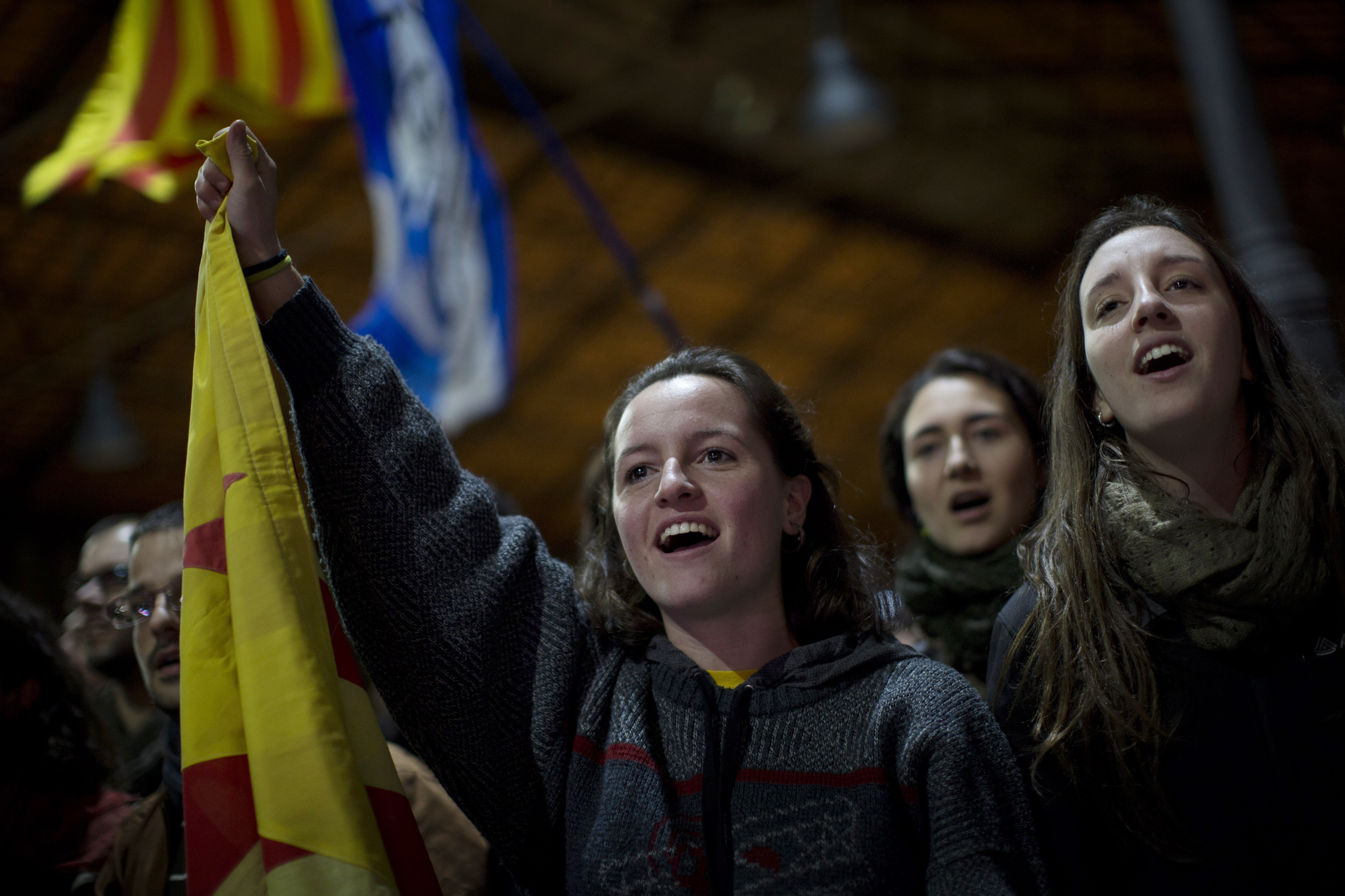 Pro independence supporters celebrate the results of an informal poll for the independence of Catalonia in Barcelona, Spain, Sunday,