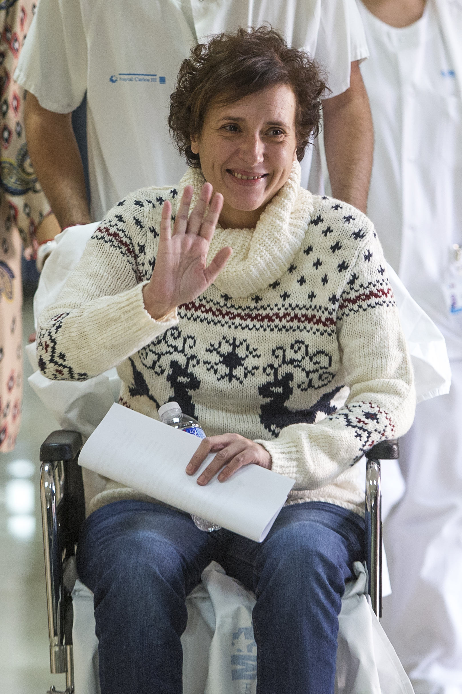 Teresa Romero, bottom right, arrives with medical workers to give a press statement before she leaves the Carlos III hospital in Madrid, Spain, Wednesday, Nov. 5, 2014.