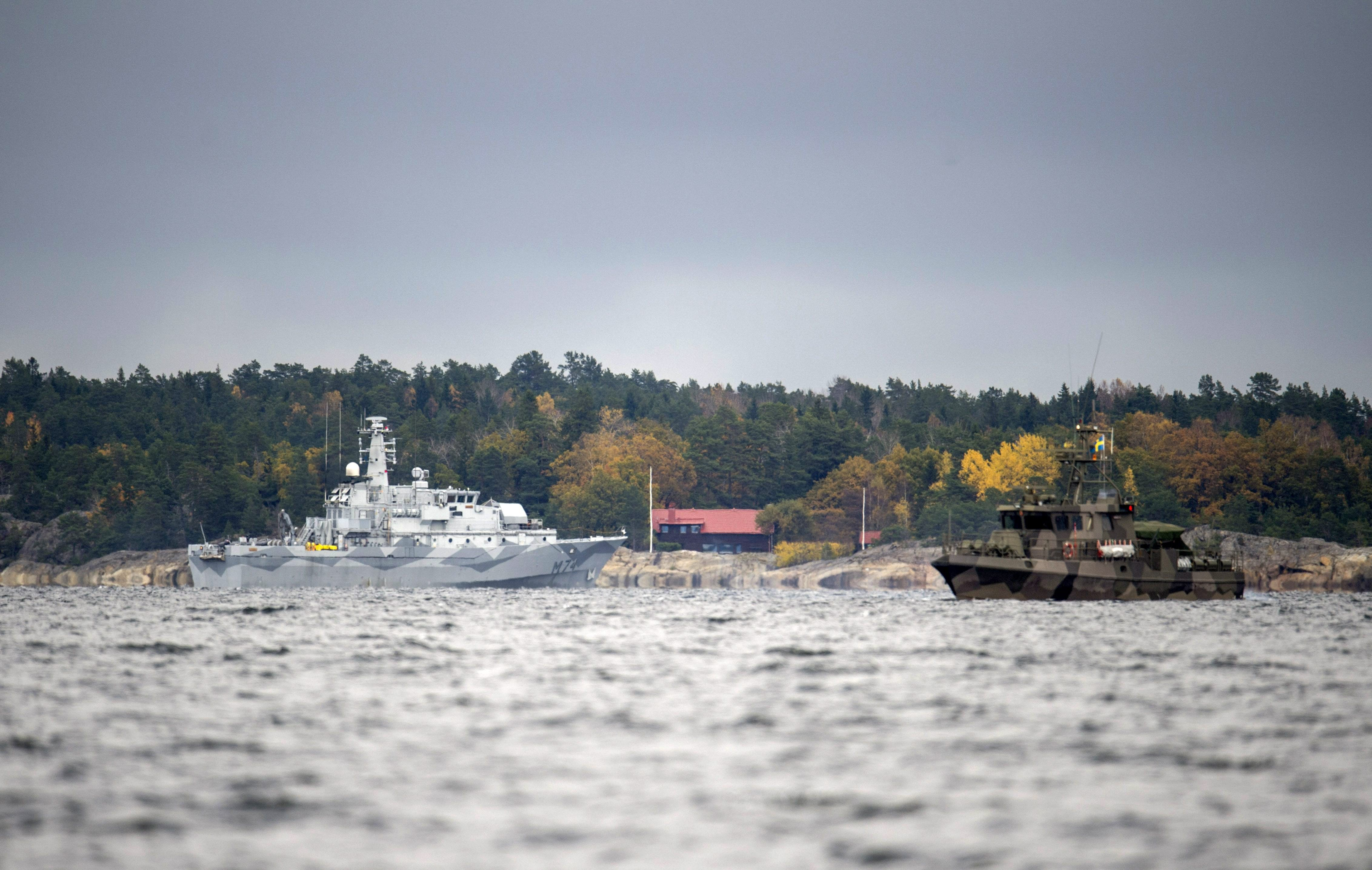 The Swedish minesweeper HMS Kullen and a guard boat in Namdo Bay on their fifth day of searching for a suspected foreign vessel in the Stockholm archipelago on October 21, 2014.