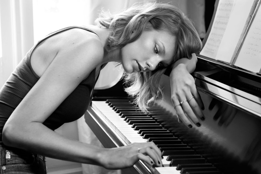 Taylor Swift photographed playing the piano at her parents home in Forest Hills, Tennessee on September 29, 2014.