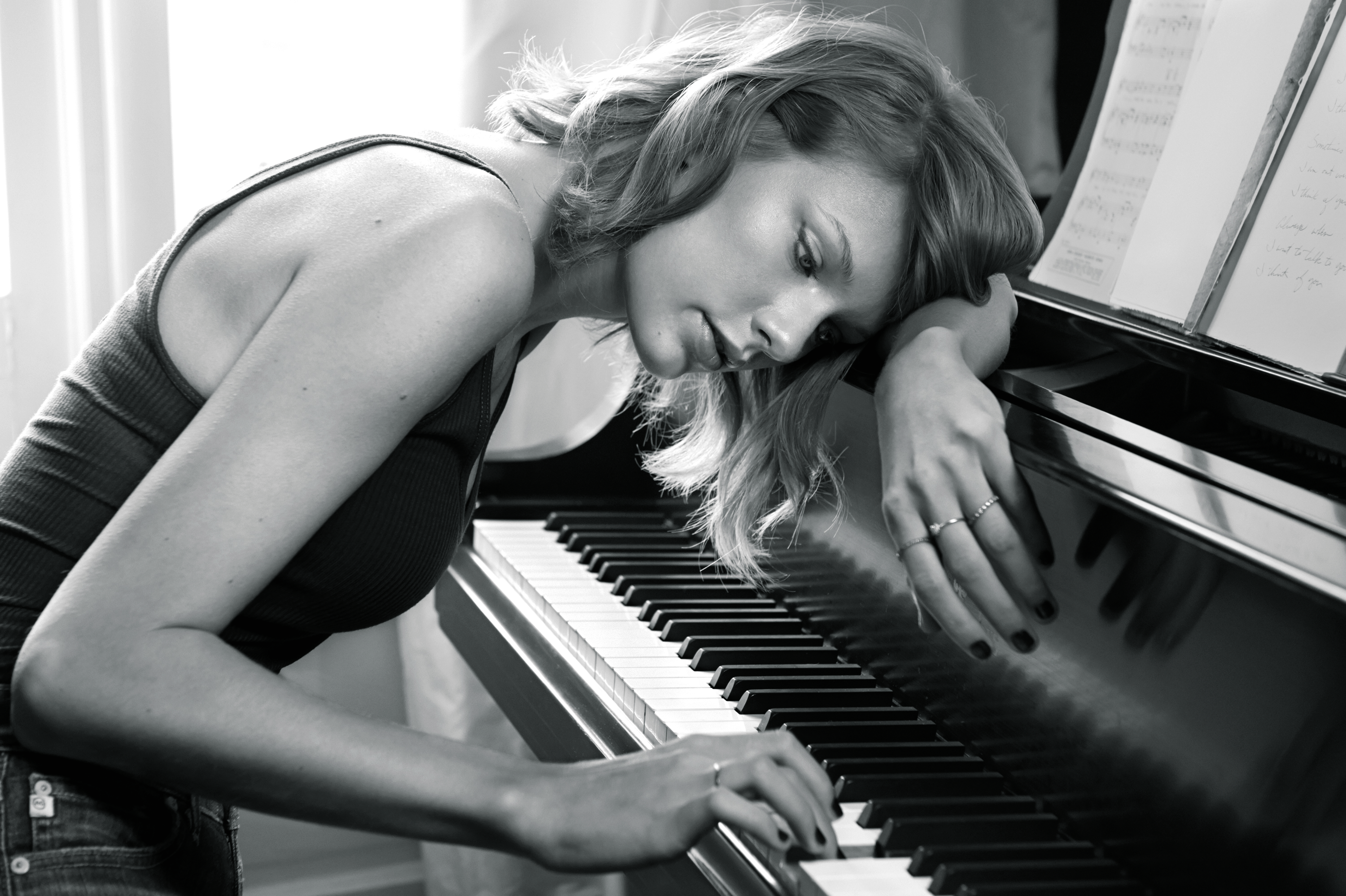 Swift, here at a piano in her parent's home, had 2014's biggest sales week with her first official pop album