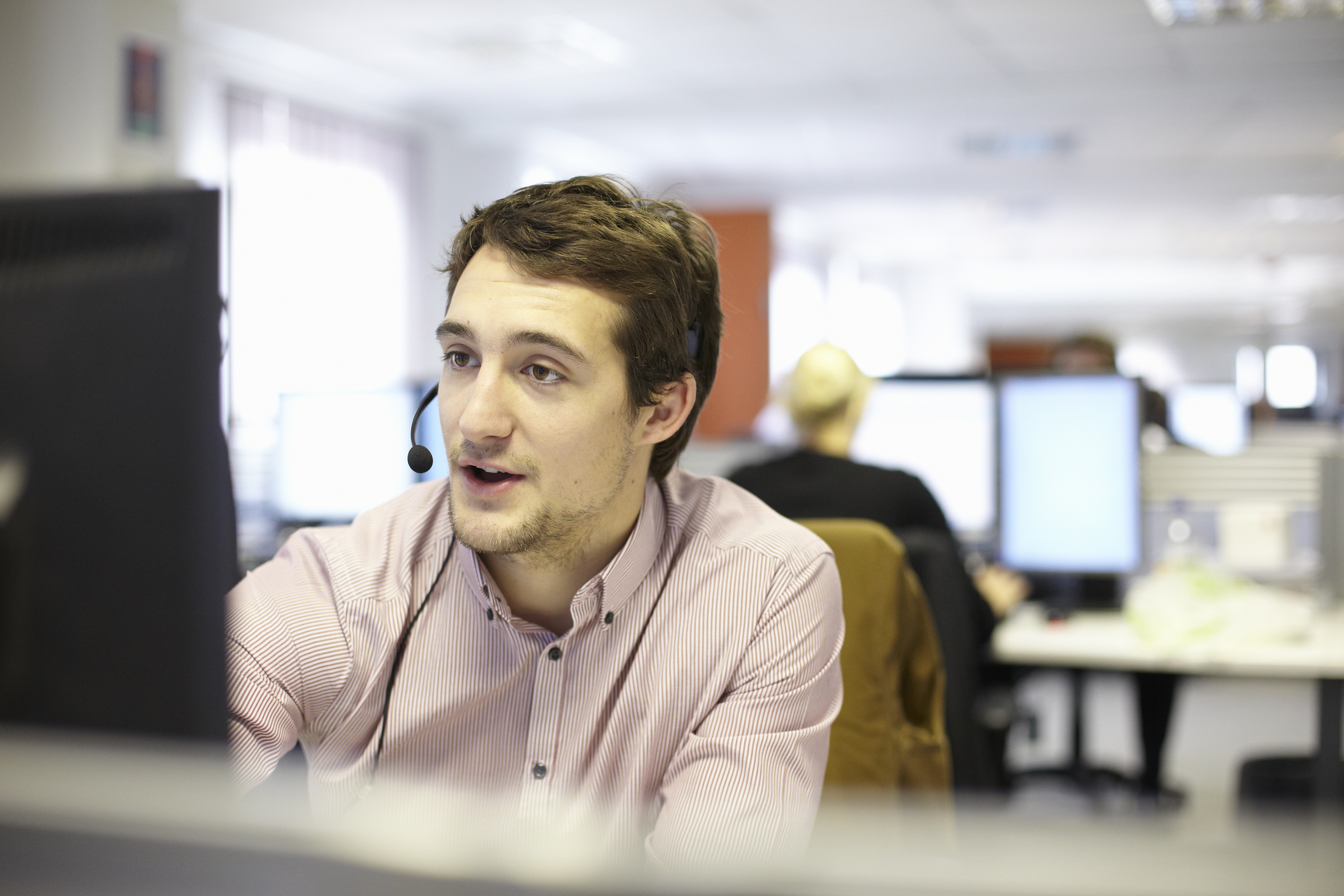 Young man in call center