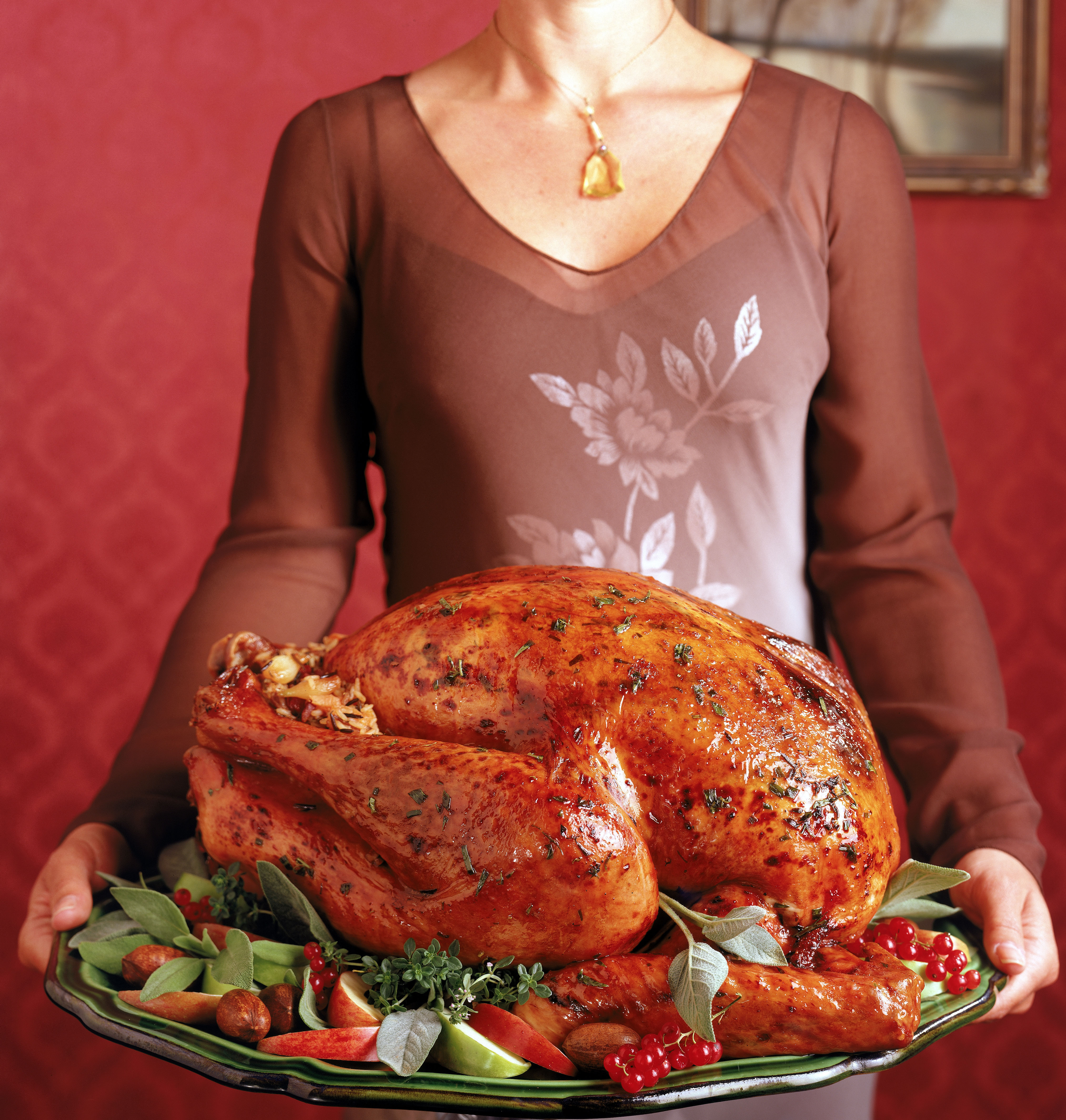 Woman with Thanksgiving turkey.