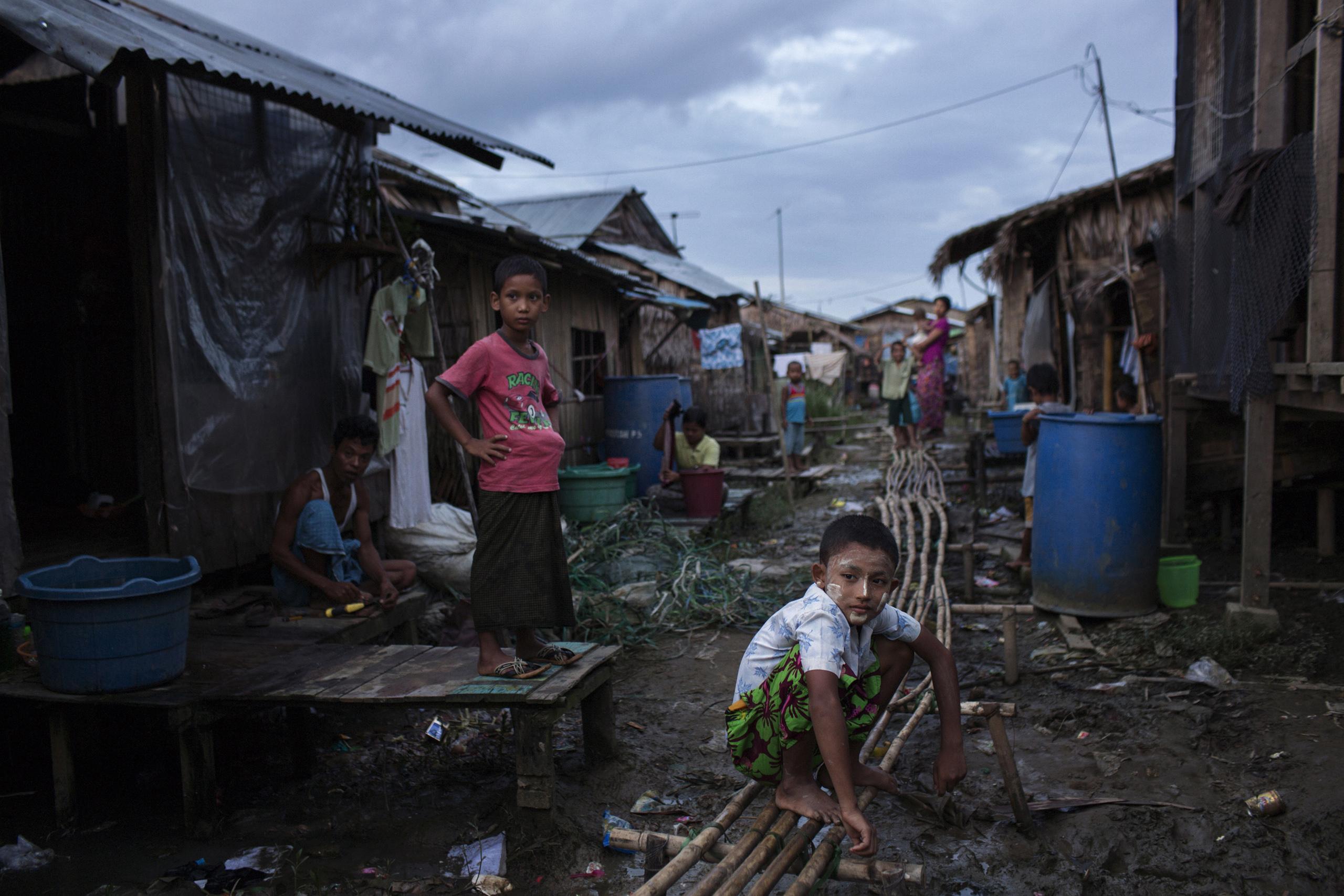 Children are seen in Daw Pon,  near Thilawa Special Economic Zone  near Yangon, Burma, Sept. 20, 2014.