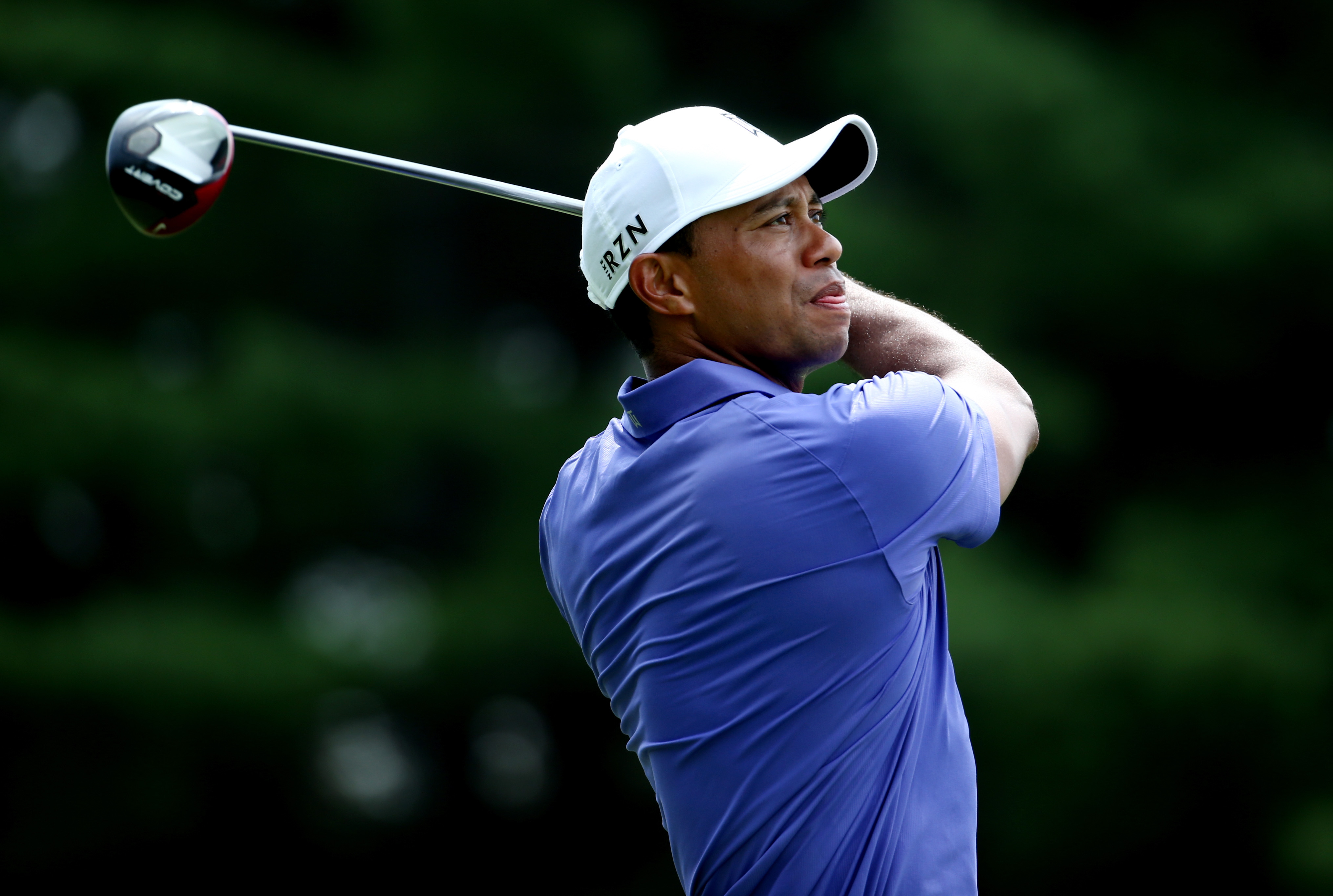 Tiger Woods of the United States hits a tee shot during the first round of the 96th PGA Championship at Valhalla Golf Club on August 7, 2014 in Louisville, Kentucky.