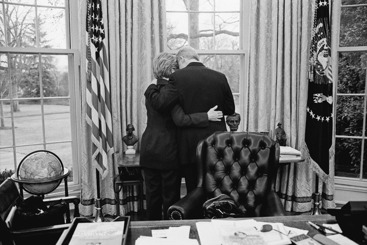 The President and the First Lady Share a private moment, one of their last in the Oval Office. Jan. 11, 2001.