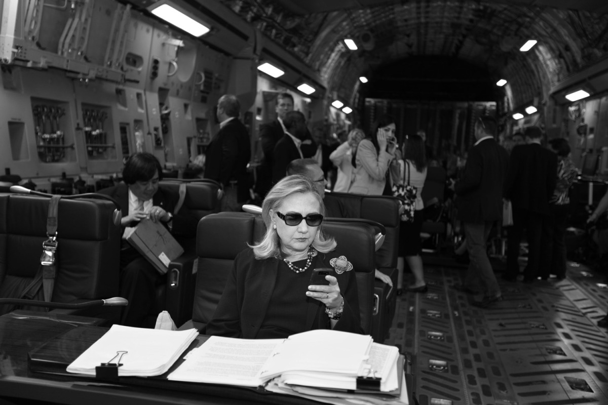 Hillary checks her messages upon departure from Malta for the as-yet-undisclosed location, Tripoli, Oct. 18, 2011. This photo was turned into a meme that circulated around the world.