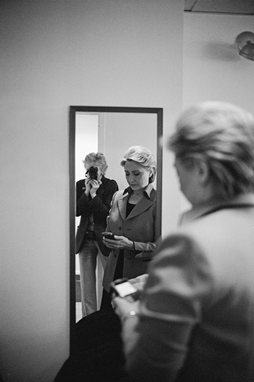 Before an appearance with David Letterman, Hillary checks her BlackBerry while Diana Walker takes their picture. Feb. 4, 2008.