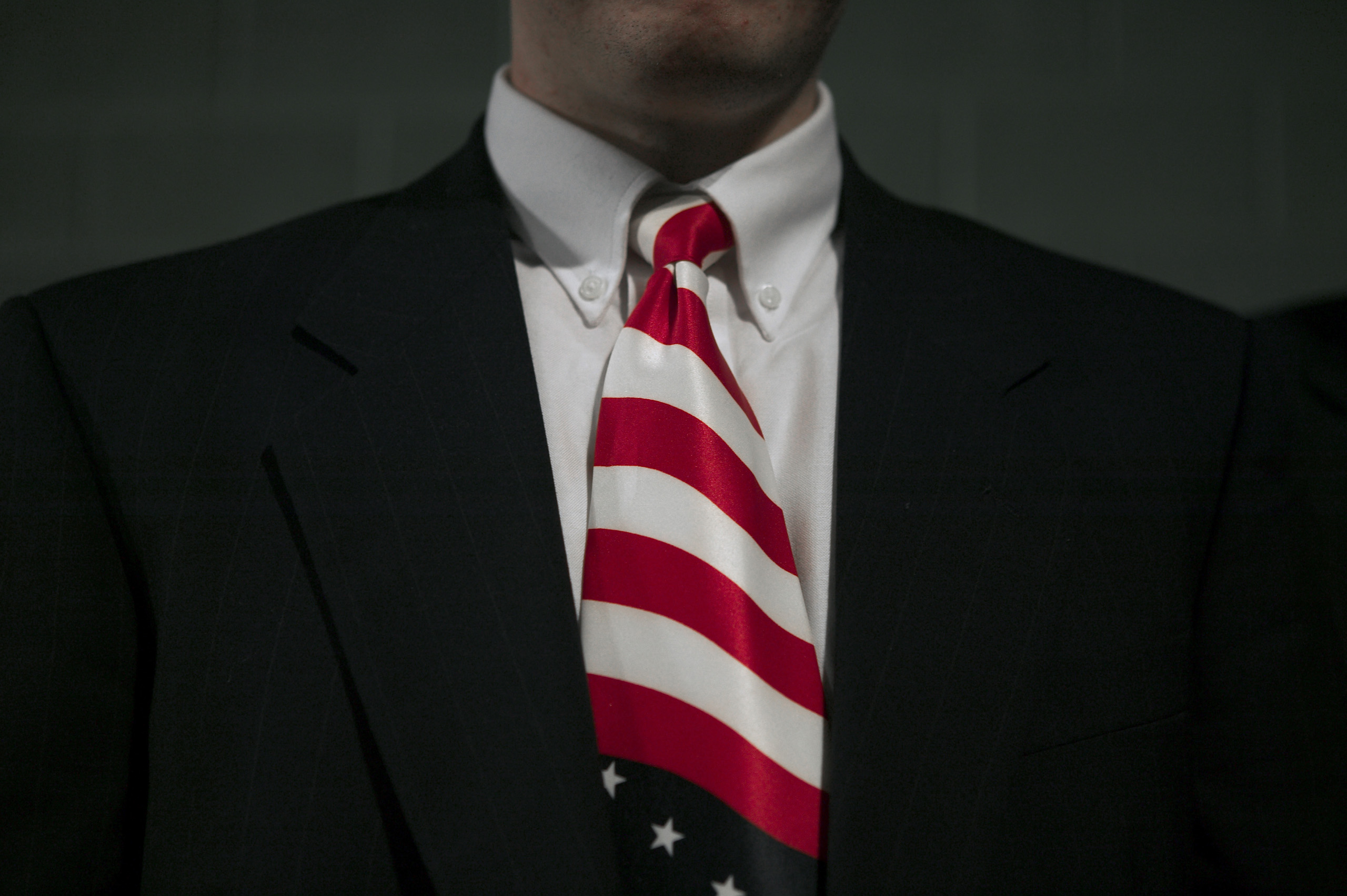 A supporter listens to U.S. President George W. Bush at an event in  Pennsylvania, Feb. 2004.