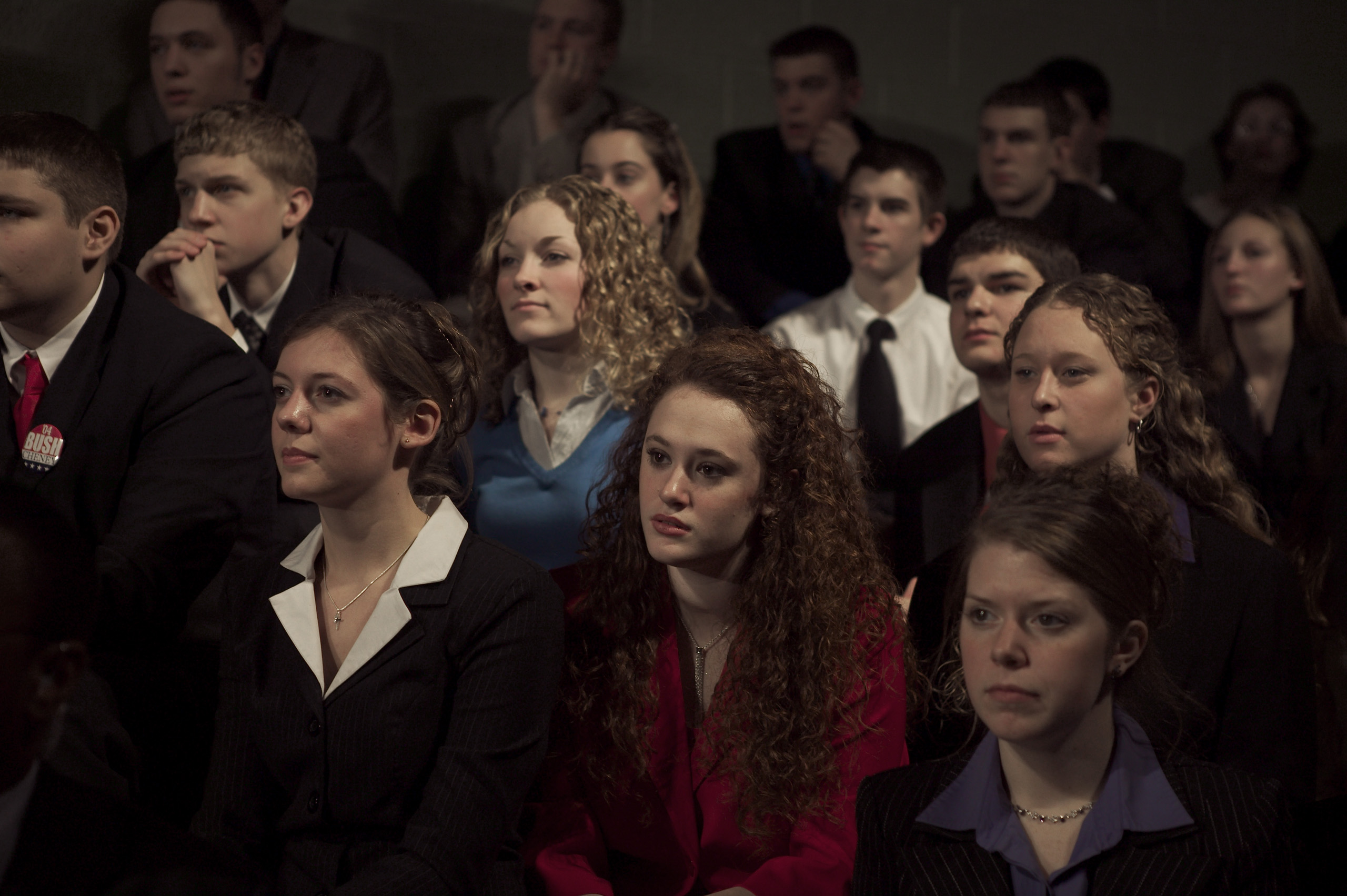 High school students listen to U.S. President George W. Bush speak about his Administration's push for better jobs through education, while at the Central Dauphin High School in Harrisburg, Pennsylvania, Feb. 12, 2004.