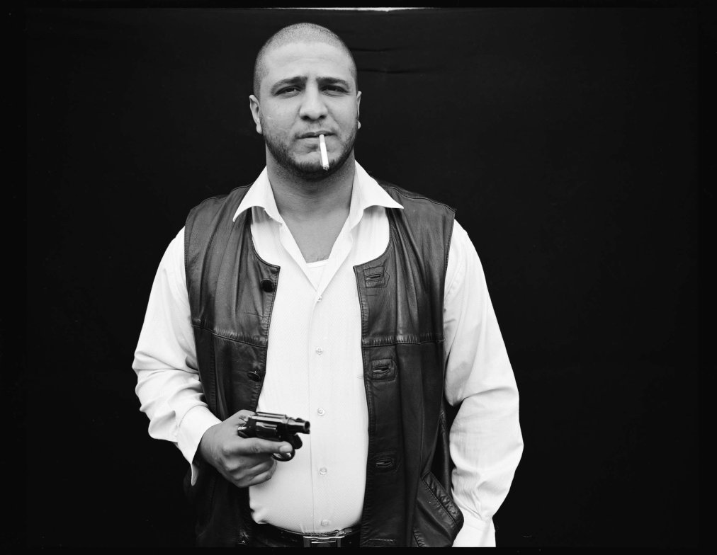 This is part of a black and white film portrait series taken in 2006 during some of the worst violence in Baghdad. At a time when it was too dangerous to work the streets, Yuri Kozyrev set up a studio in the backyard at TIME's bureau and photographed everyone who passed by.