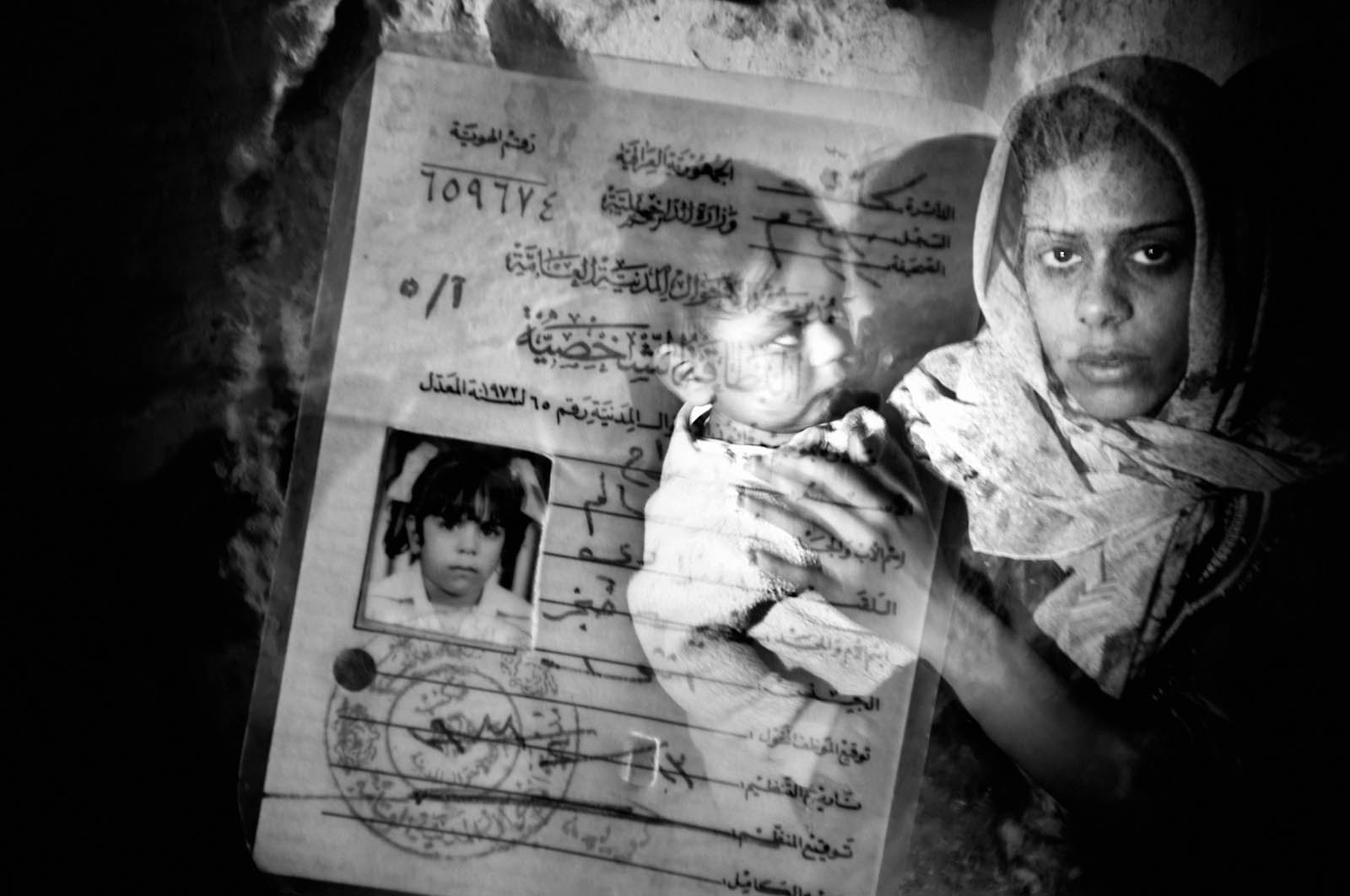 In this unpublished double exposure photo, a Sunni woman stands for a portrait in the Adhamiyah neighborhood of Baghdad, Iraq on Jan. 22, 2007.