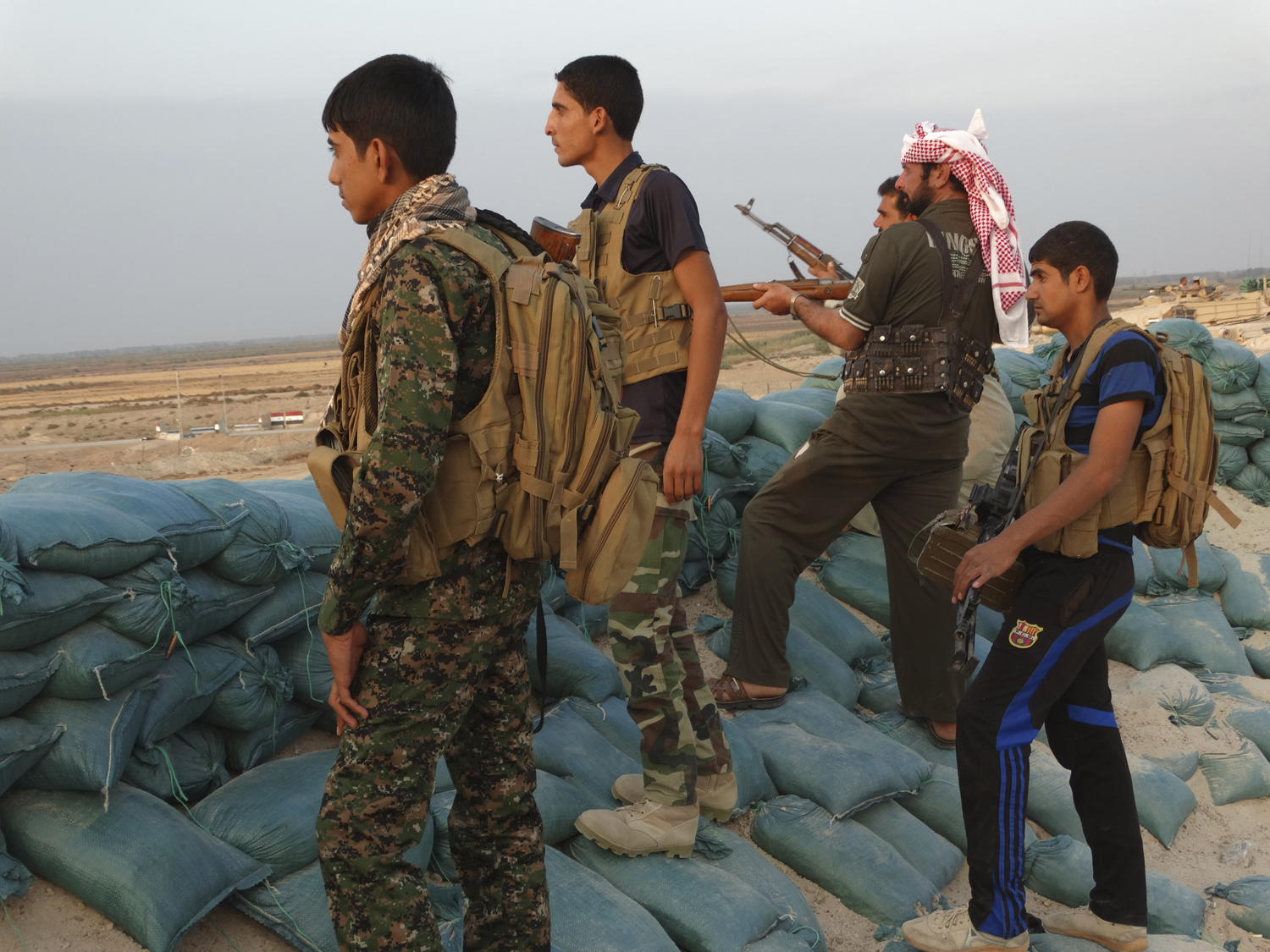 Tribal fighters look on as they take part in an intensive security deployment against ISIS militants in the town of Amriyat al-Falluja,in Anbar province on October 31, 2014.