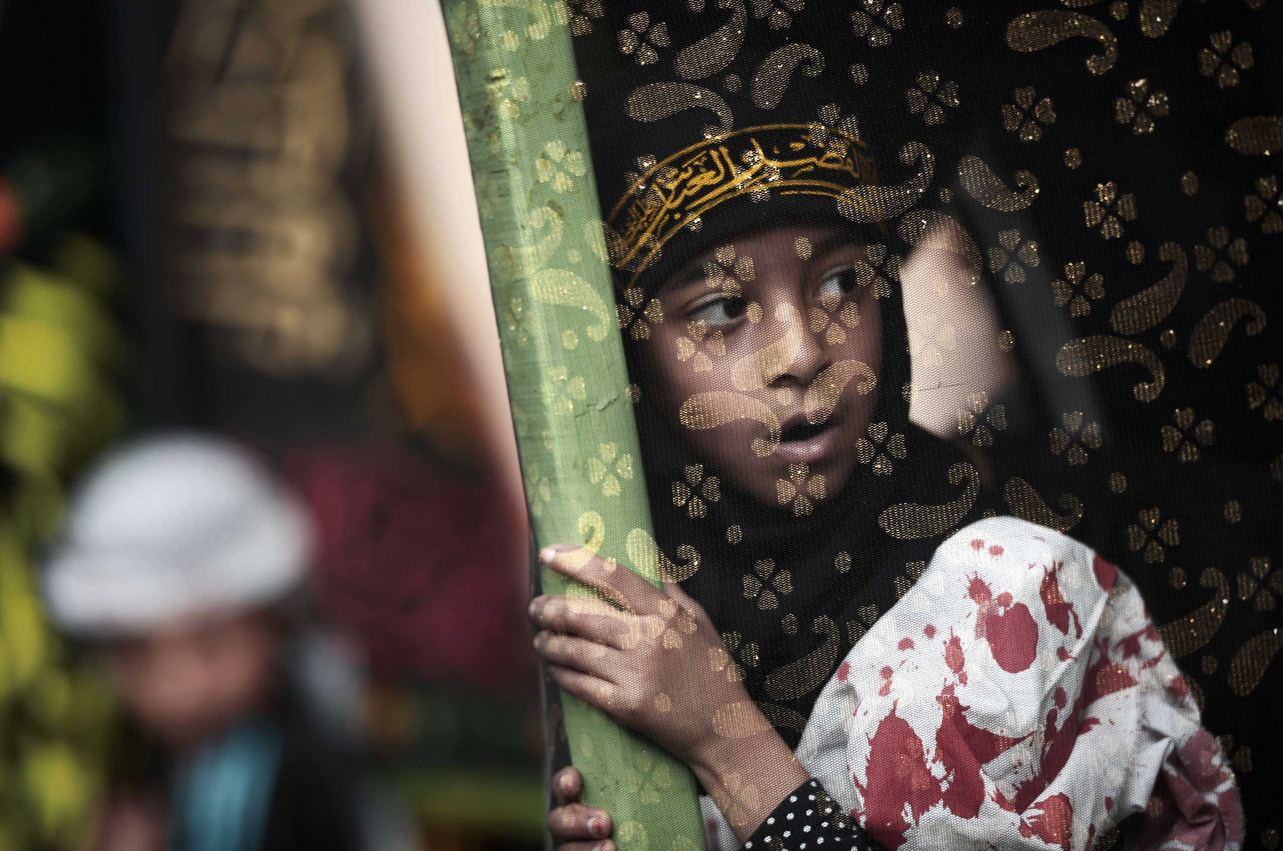 Nov. 4, 2014.                                A Bahraini Shiite Muslims girl takes part in a ceremony marking Ashura, which commemorates the seventh century slaying of Imam Hussein, the grandson of Prophet Mohammed, in the village of Sanabis, west of Manama.