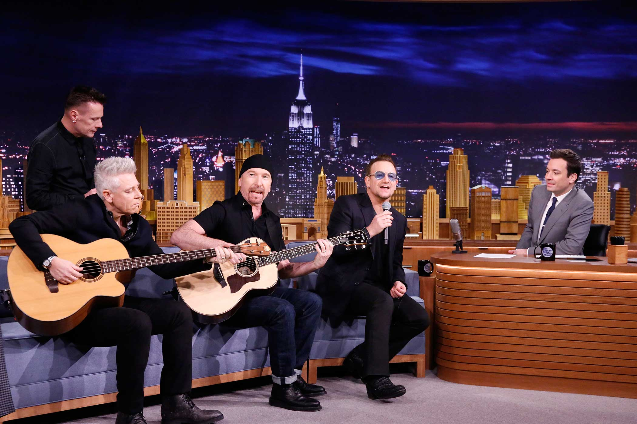 Larry Mullen, Jr., Adam Clayton, The Edge and Bono of musical guest U2 perform on the Tonight Show Starring Jimmy Fallon on February 17, 2014.