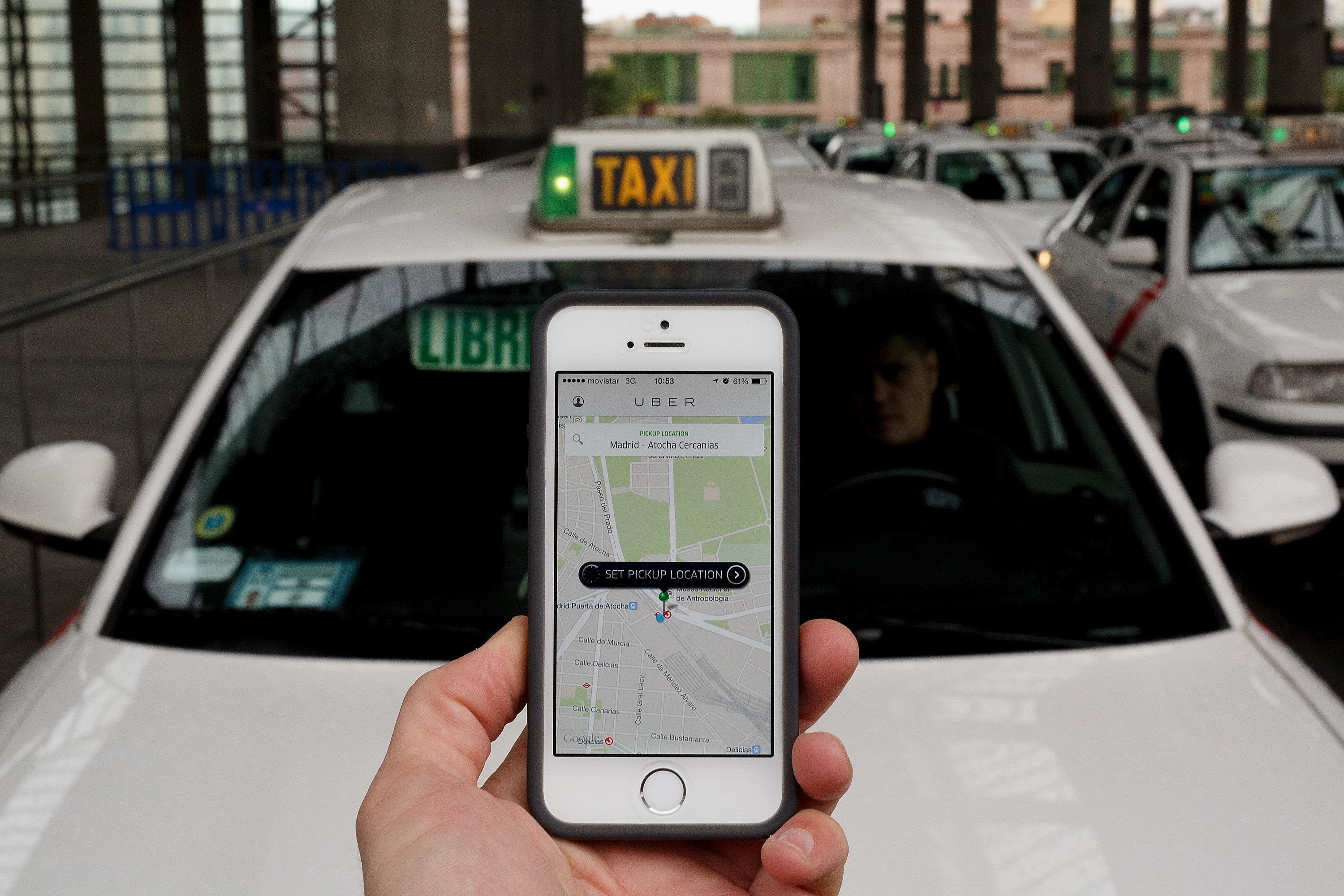 In this photo illustration the new smart phone taxi app 'Uber' shows how to select a pick up location at Atocha Station on October 14, 2014 in Madrid, Spain.
