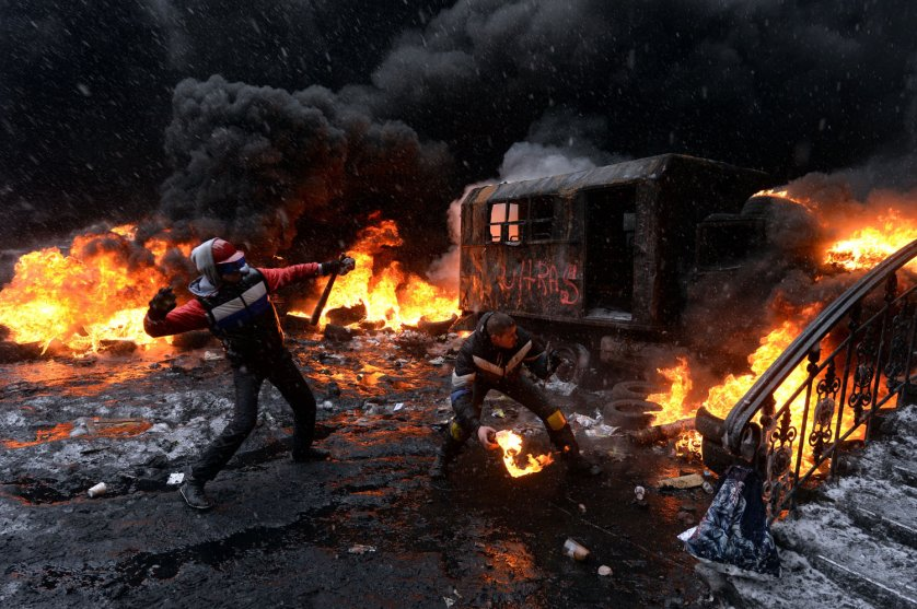 A protestor throws a molotov cocktail at riot police in the centre of Kiev, Ukraine, Jan. 22, 2014.