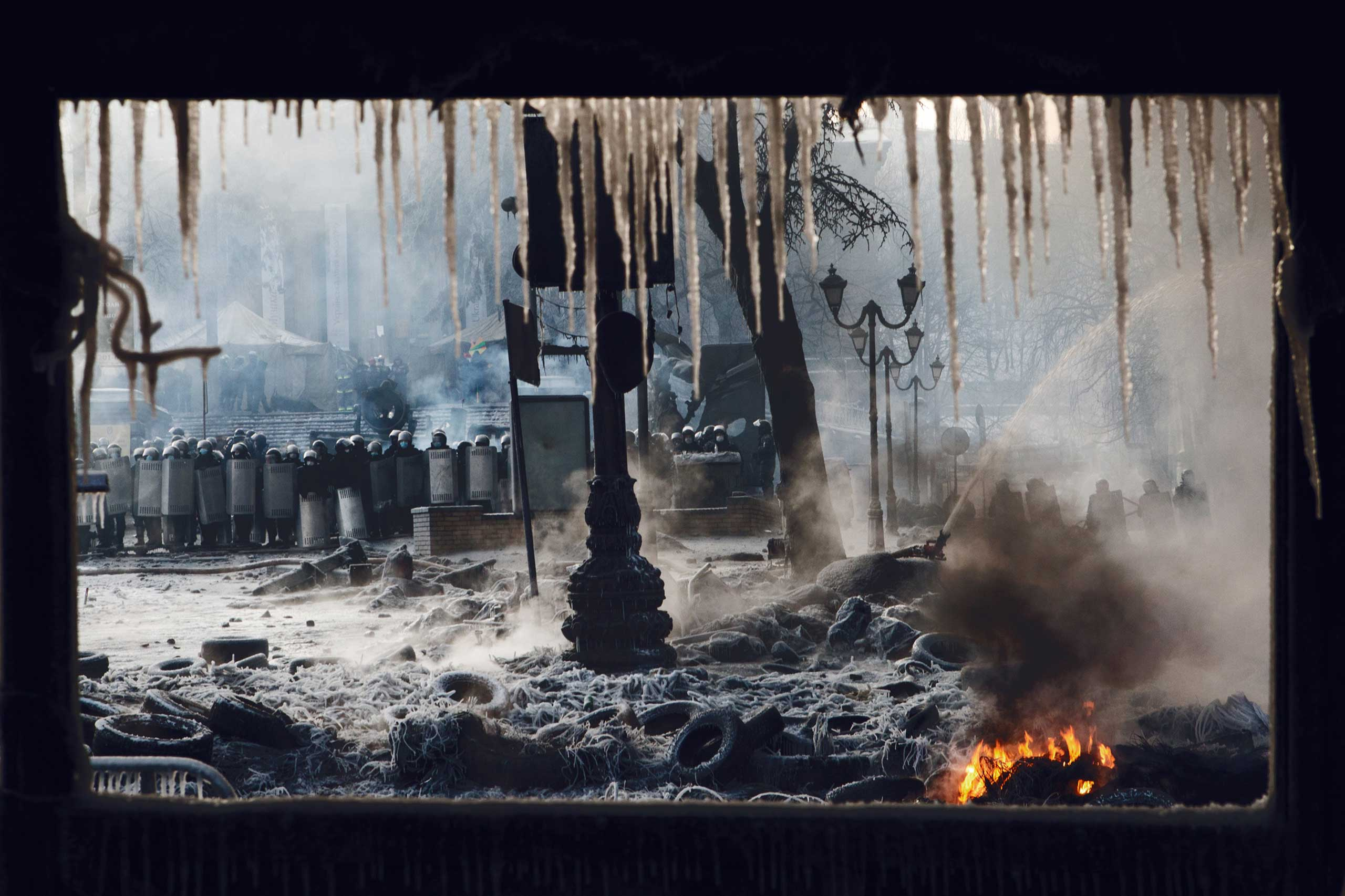 Jan. 25, 2014. Riot police keep a fire hose aimed at protesters continuously during rioting on Hrushevskoho Street in central Kiev. Freezing temperatures creates a dramatic landscape of fire and ice. From Fire and Ice in Kiev: Ross McDonnell on Ukraine's Front Line