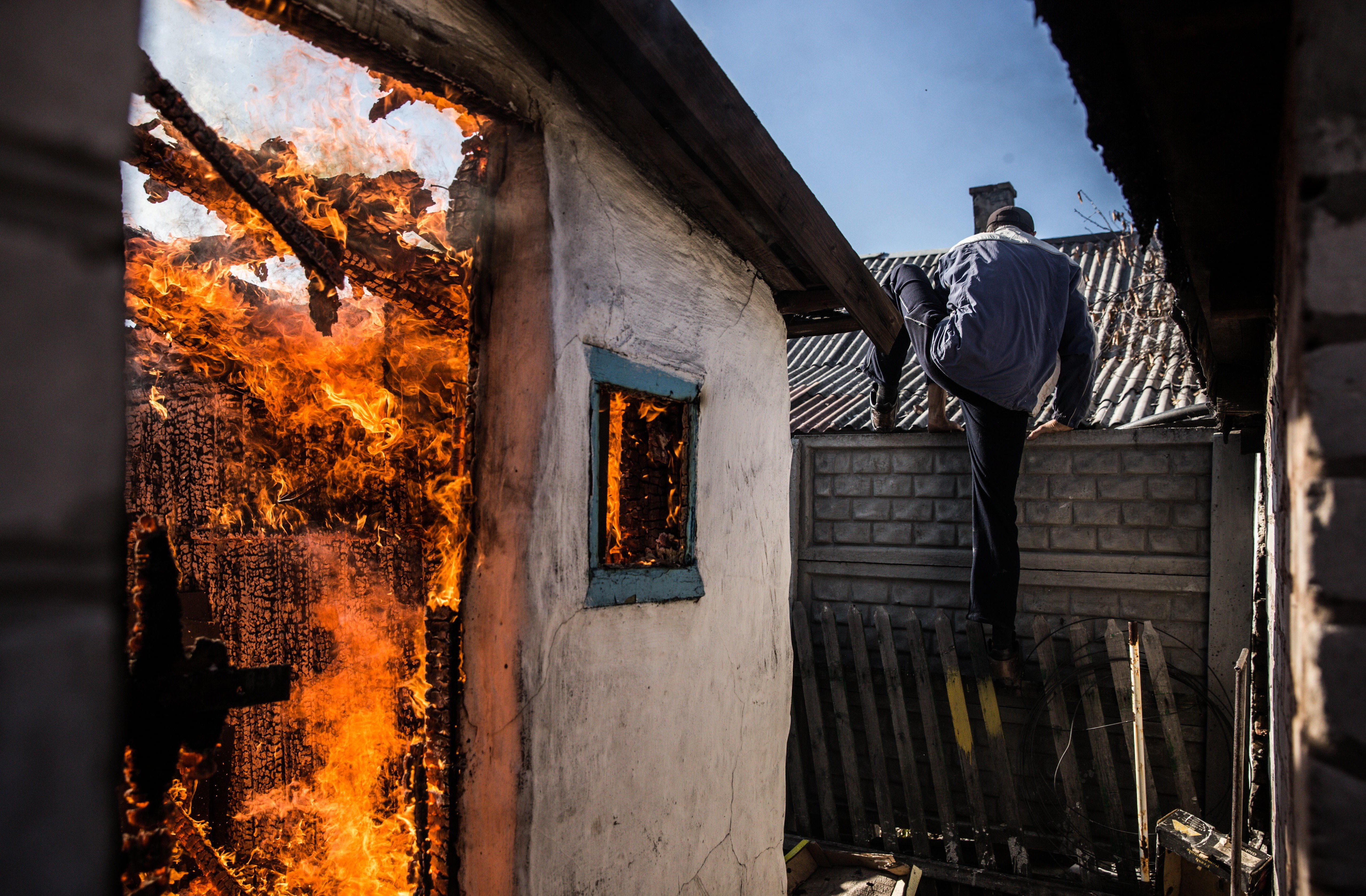 A house on fire in the aftermath of an overnight shelling attack in Donetsk, Ukraine on Nov. 9, 2014.