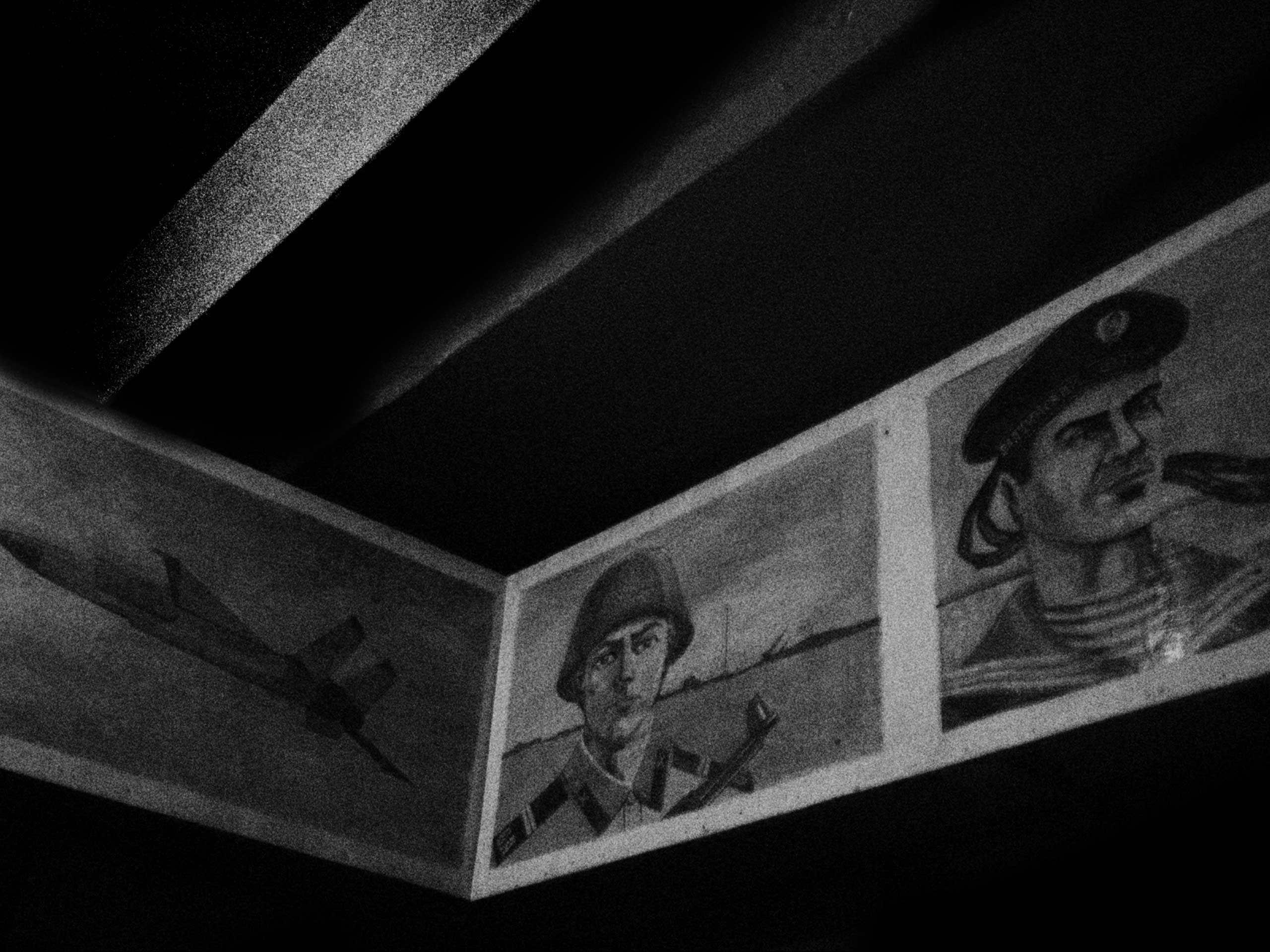 The shelter in Trudovski was built in the event of a nuclear fallout. It is emblazoned with Soviet military iconography like these portraits of Army soldiers and Navy sailors. Trudovski, Donetsk Oblast, Ukraine. Oct. 18, 2014.