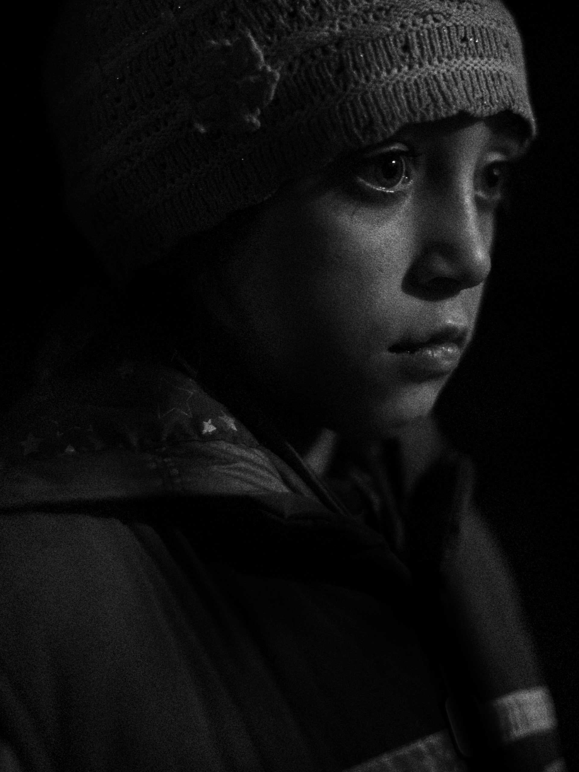 Raisa, 8 years old, is seen in a bunker. Over 150 people live in a network of rooms underneath the town hall. Schools have stopped operating since the conflict began with several school buildings themselves becoming targets of shelling, although neither side has claimed responsibility for these strikes. Donetsk, Petrovsky District of Ukraine. Nov. 1, 2014.
