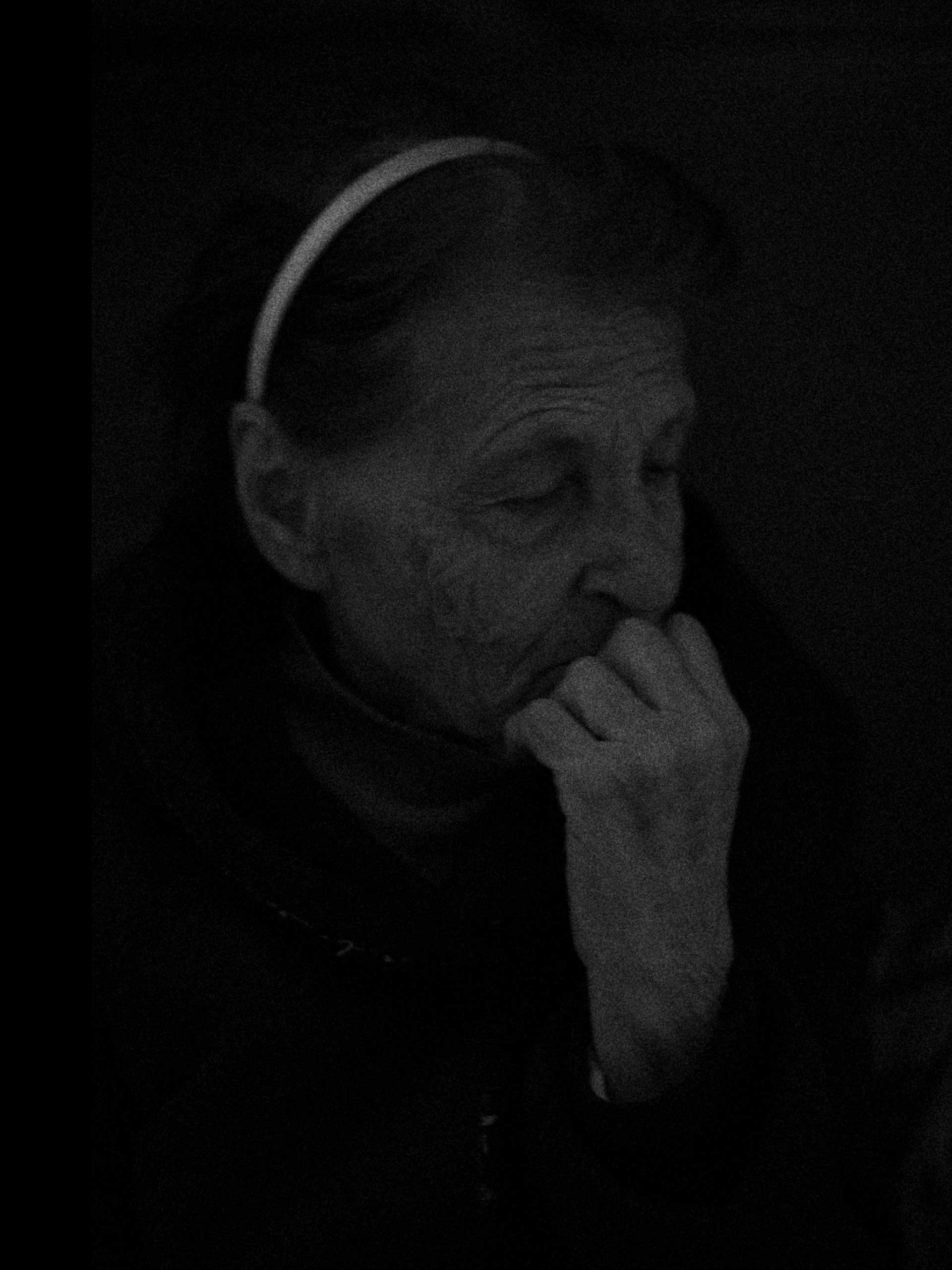 A portrait of Valentina is taken as we listened to shelling close to the shelter. The noise was actually the aftershock of a Tochka-U missile hitting a chemical plant some kilometers away sending a shockwave across much of the area. Donetsk, Kievski District, Ukraine. Oct. 20, 2014.