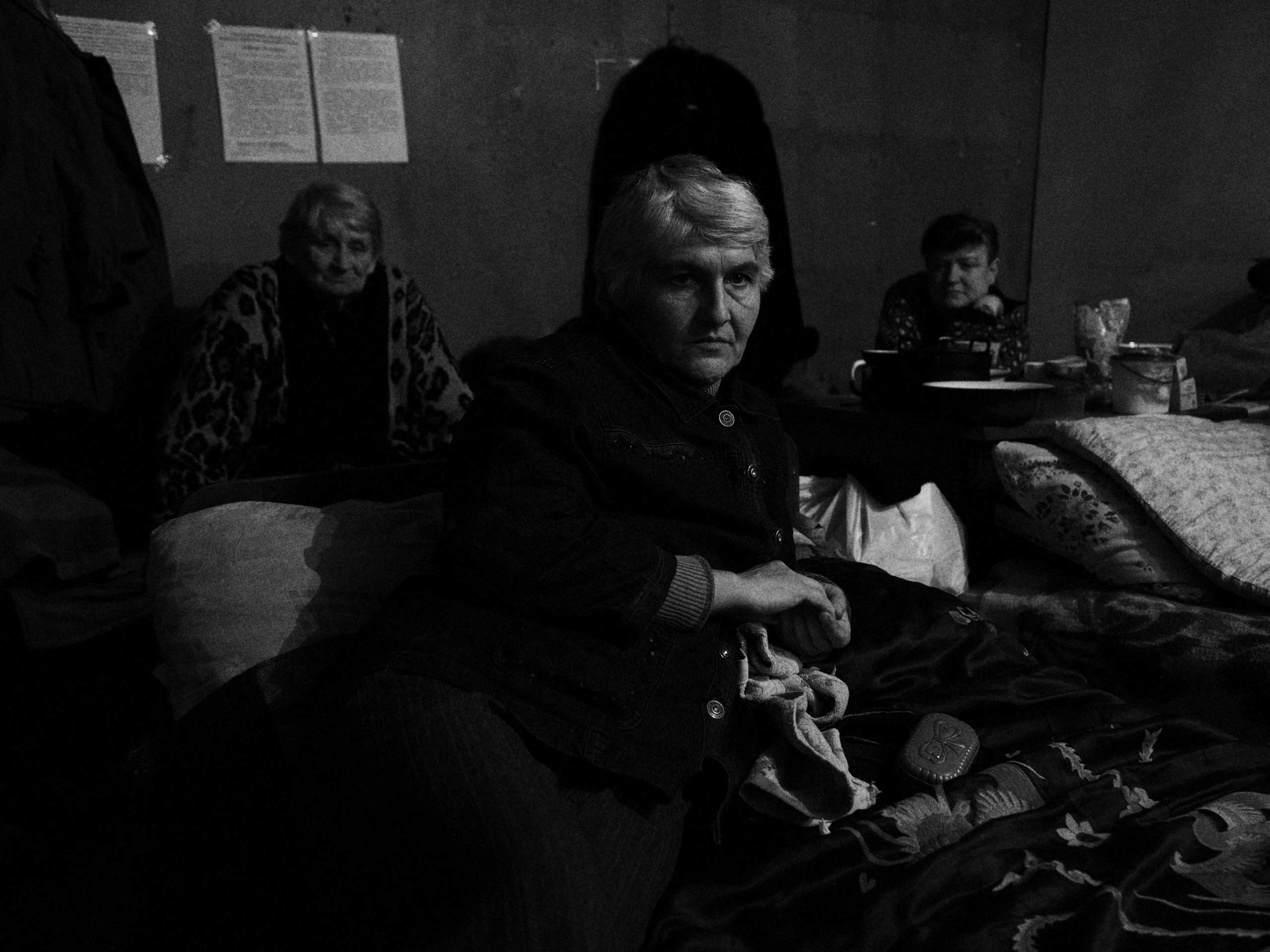 Tanya and two other women are pictured where they sleep in the shelter. Days pass slowly and stress begins to affect the residents. Trudovski, Donetsk Oblast, Ukraine. Nov. 1, 2014.