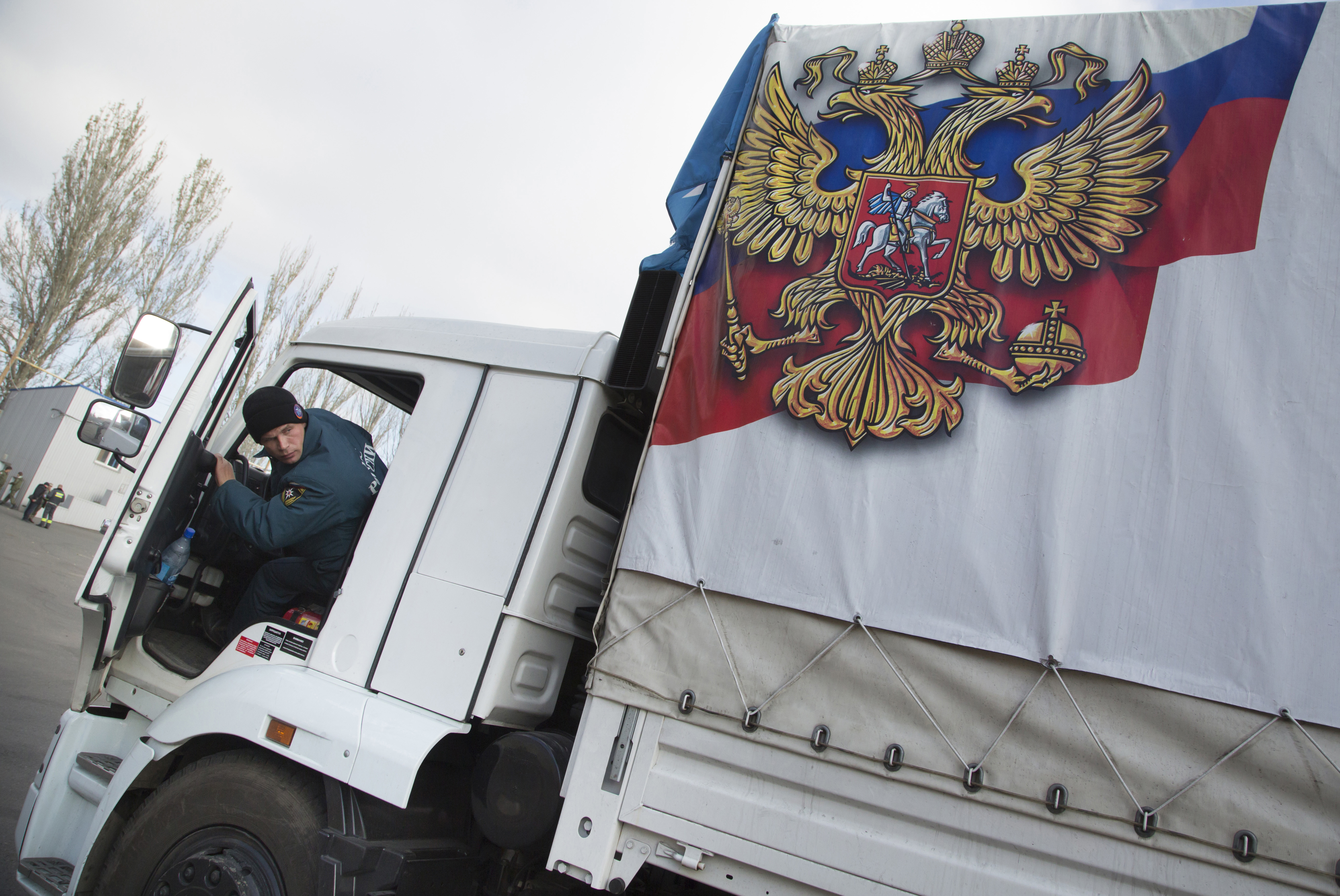 A driver parks a truck of a Russian humanitarian-aid convoy at a warehouse in the city of Donetsk, eastern Ukraine, on Oct. 31, 2014