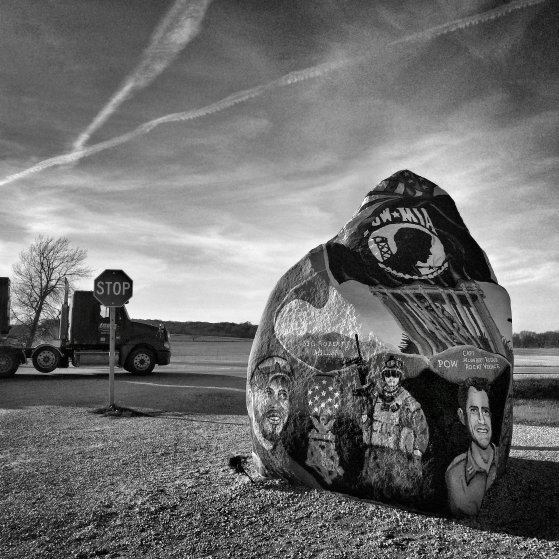 """The """"Freedom Rock"""" sits along a county road between Menlo and Greenfield, Iowa just south of Interstate 35 on Nov. 2, 2014. It's repainted every year by mural artist Ray """"Bubba"""" Sorensen II with a different memorial message and a """"Thank You"""" dedicated to U.S. Veterans."""