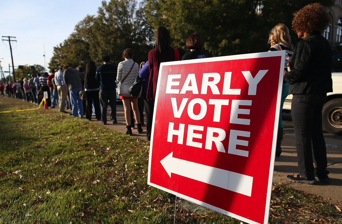 People line up for early voting outside of the Pulaski County Regional Building on Nov. 3, 2014, in Little Rock, Ark.