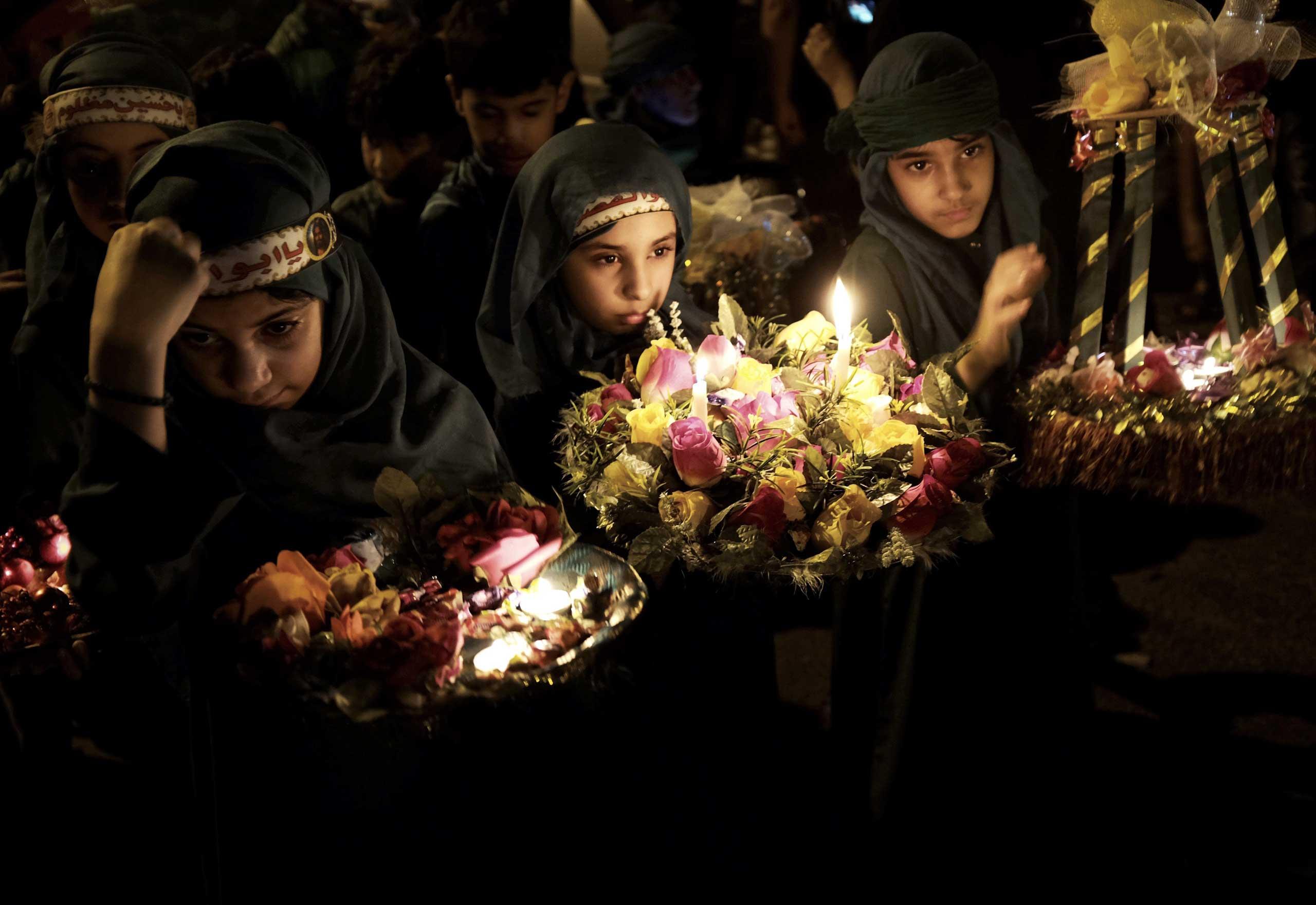 Nov. 1, 2014. Bahraini Shiite Muslim girls take part in a ceremony marking Ashura in the village of Sanabis, west of Manama.
