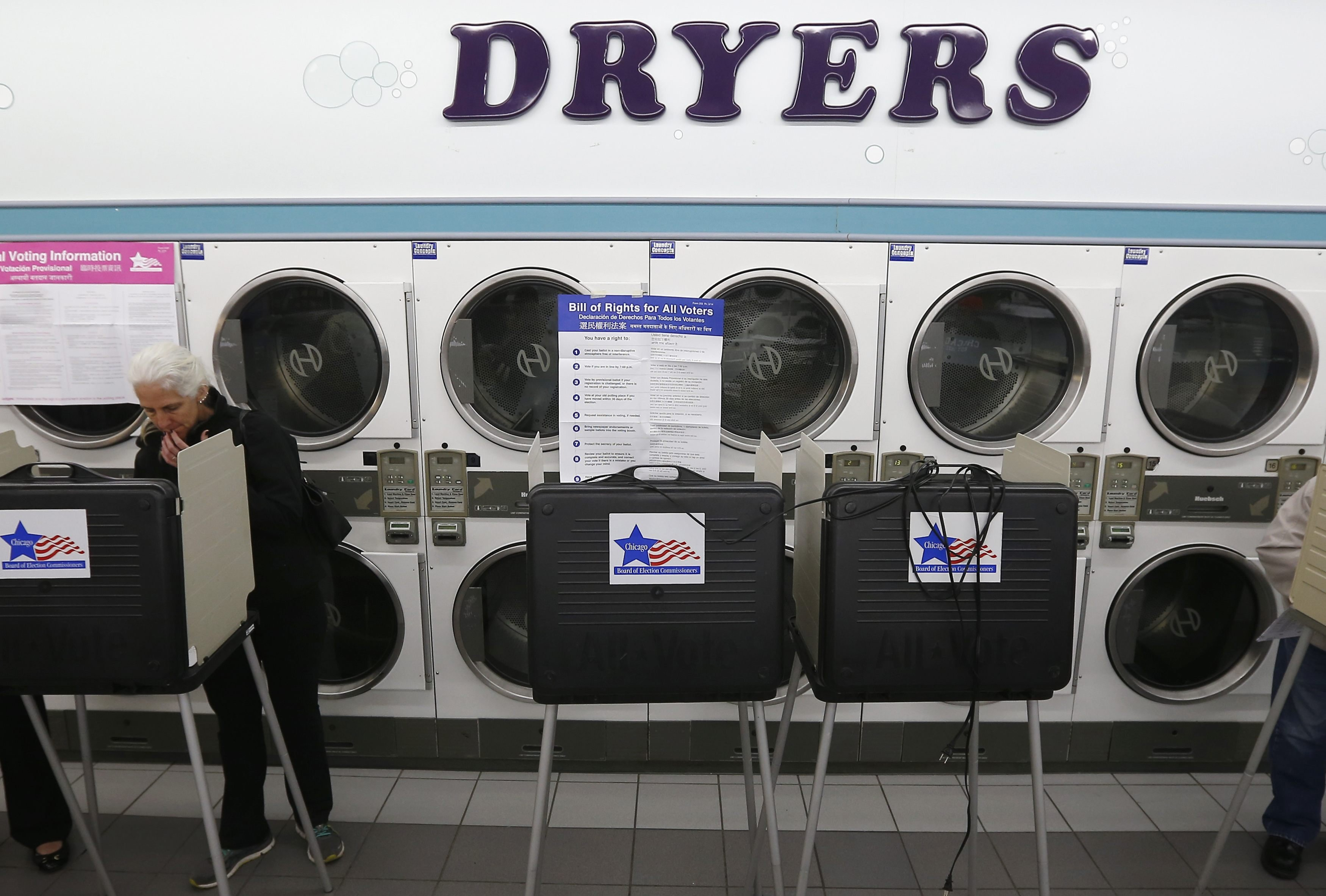 A voter looks over her ballot for the U.S. midterm elections at a laundromat used as a polling station in Chicago on Nov. 4, 2014.
