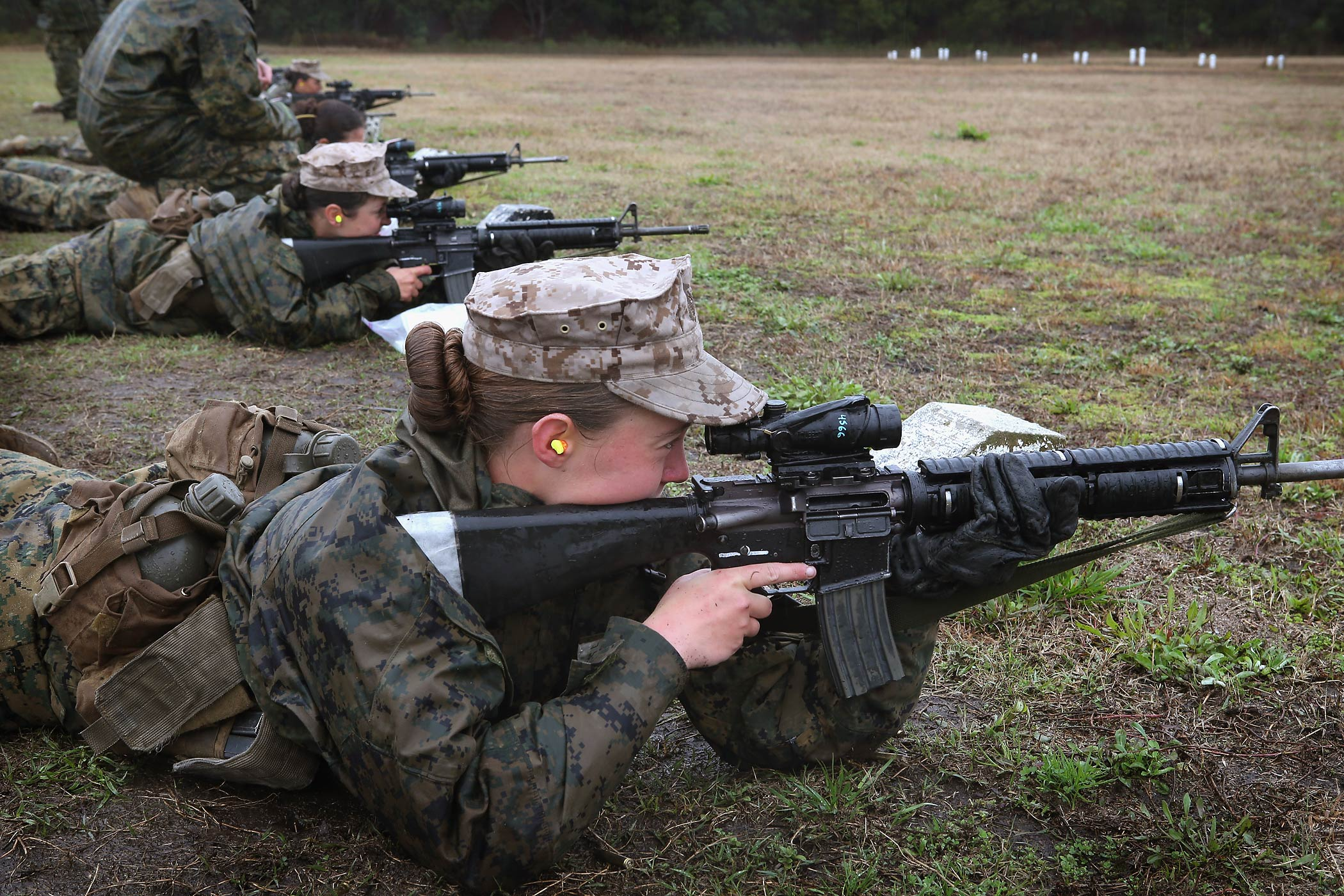 Female Marine recruits fire on the rifle range during boot camp February 25, 2013 at MCRD Parris Island, South Carolina.