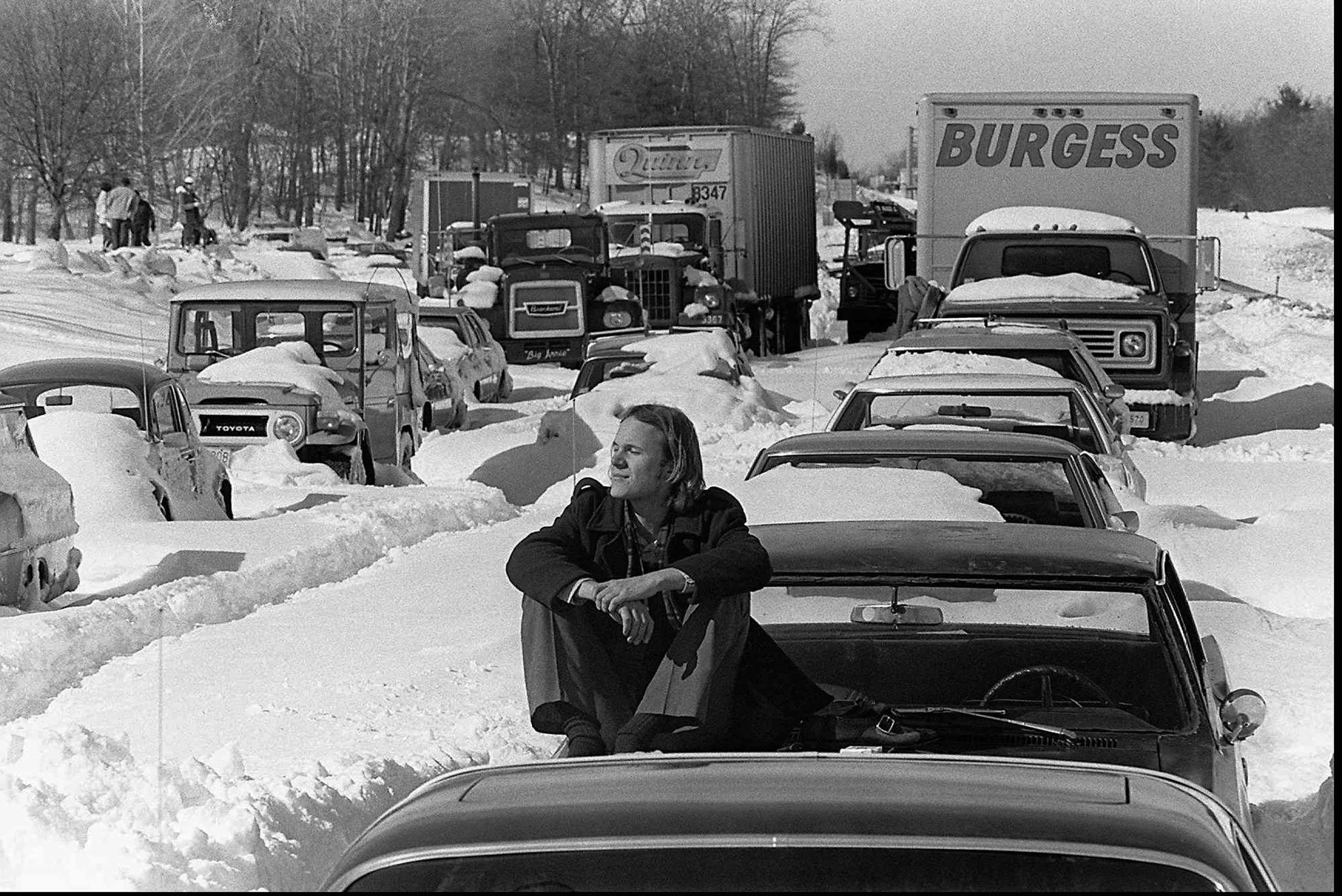 <b>The Blizzard of 1978 (Feb. 5-7 1978)</b> Hurricane-force winds, up to 90mph, and snow totals of up to 3 feet defined this blizzard. Here, Roy Sodersjerna of Higham, Mass. suns himself on the hood of his car, which is stuck in the snow on Massachusetts Route 128 in Dedham, Mass. on Feb. 9, 1978.