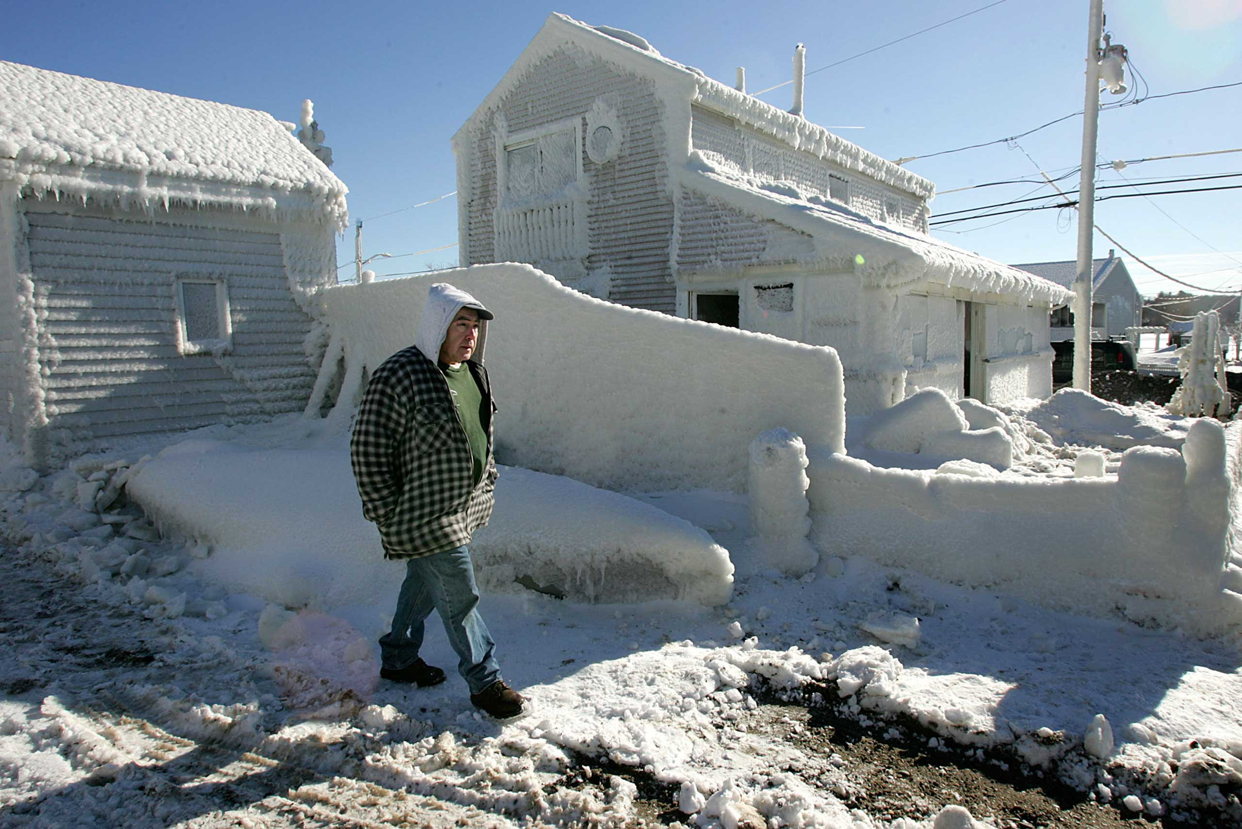 <b>The Blizzard of 2005 (Jan. 20-24, 2005)</b> Snowfall blanketed the Northeast, with areas around Boston reporting 3-5 inches of snowfall per hour and totalling 43 inches. Here, Sam Germaine walks past the frozen entrance to his home in Hull, Mass. on Jan. 25, 2005.