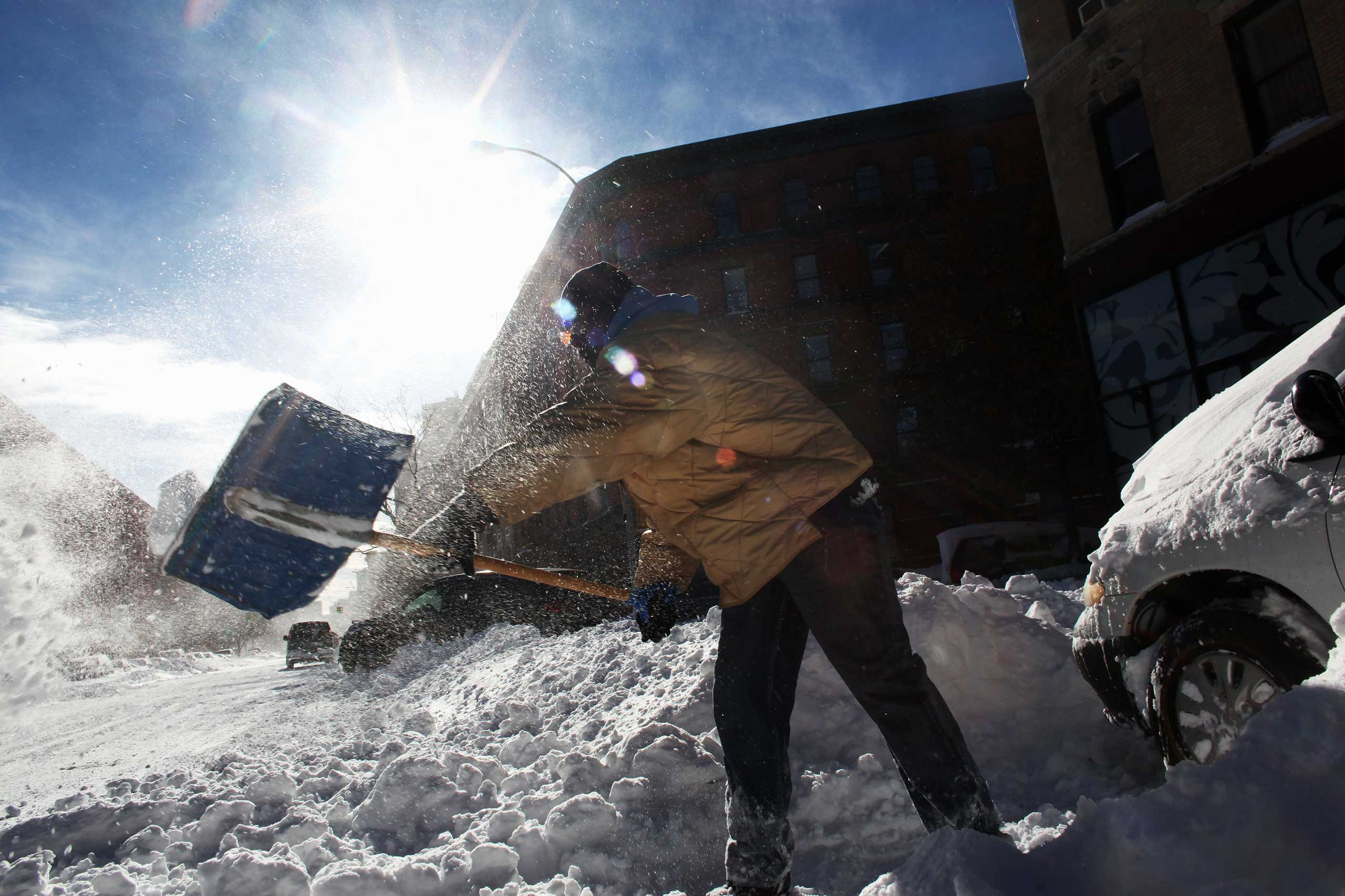 <b>The Post-Christmas Storm of 2010 (Dec. 25-28, 2010)</b> New York City received over 20 inches of snowfall. Here, a man digs out his car in the Harlem neighborhood of New York City on Dec. 27, 2010.