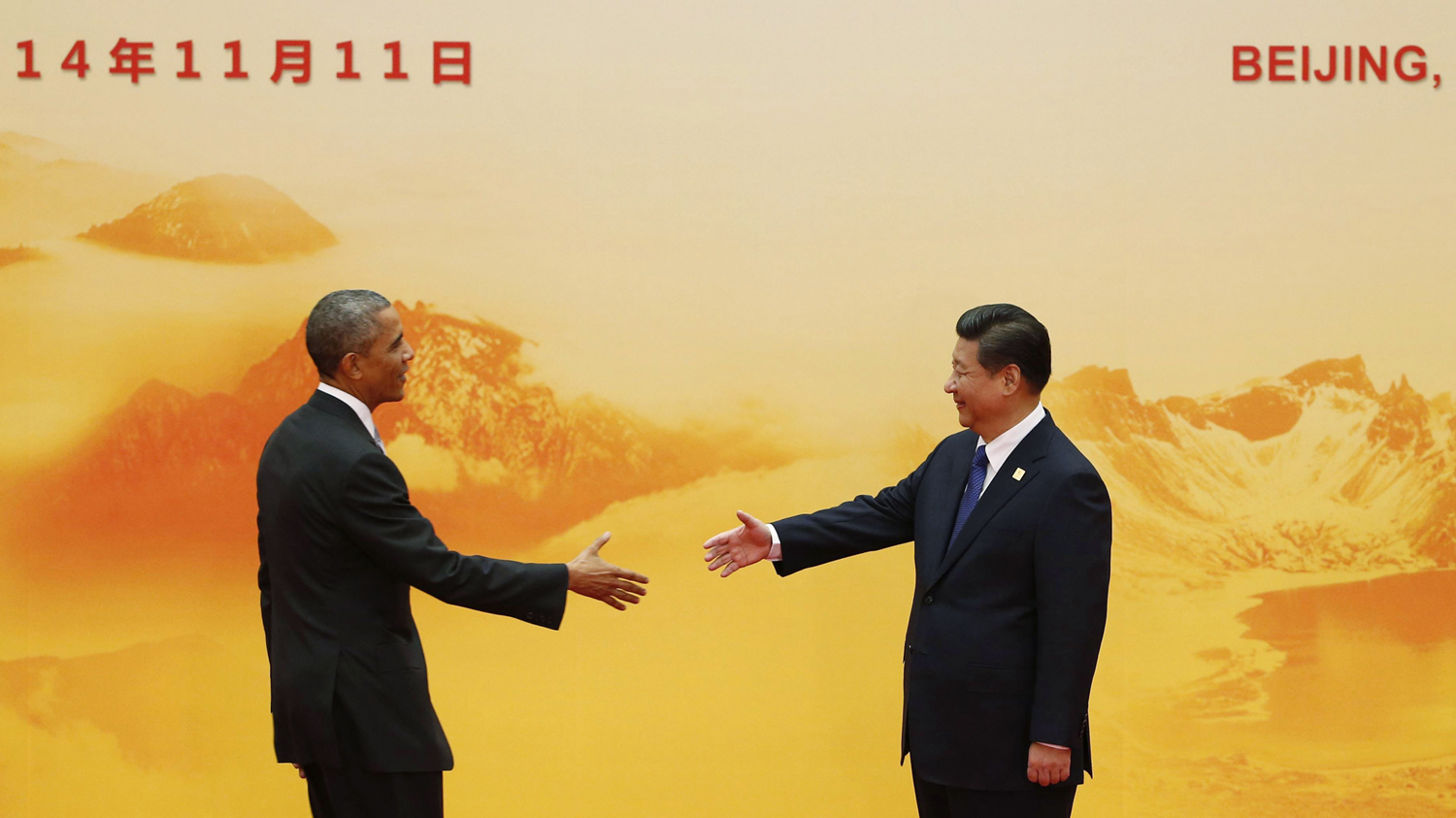 U.S. President Barack Obama (L) shakes hands with China's President Xi Jinping during the Asia Pacific Economic Cooperation (APEC) forum in Beijing on November 11, 2014.