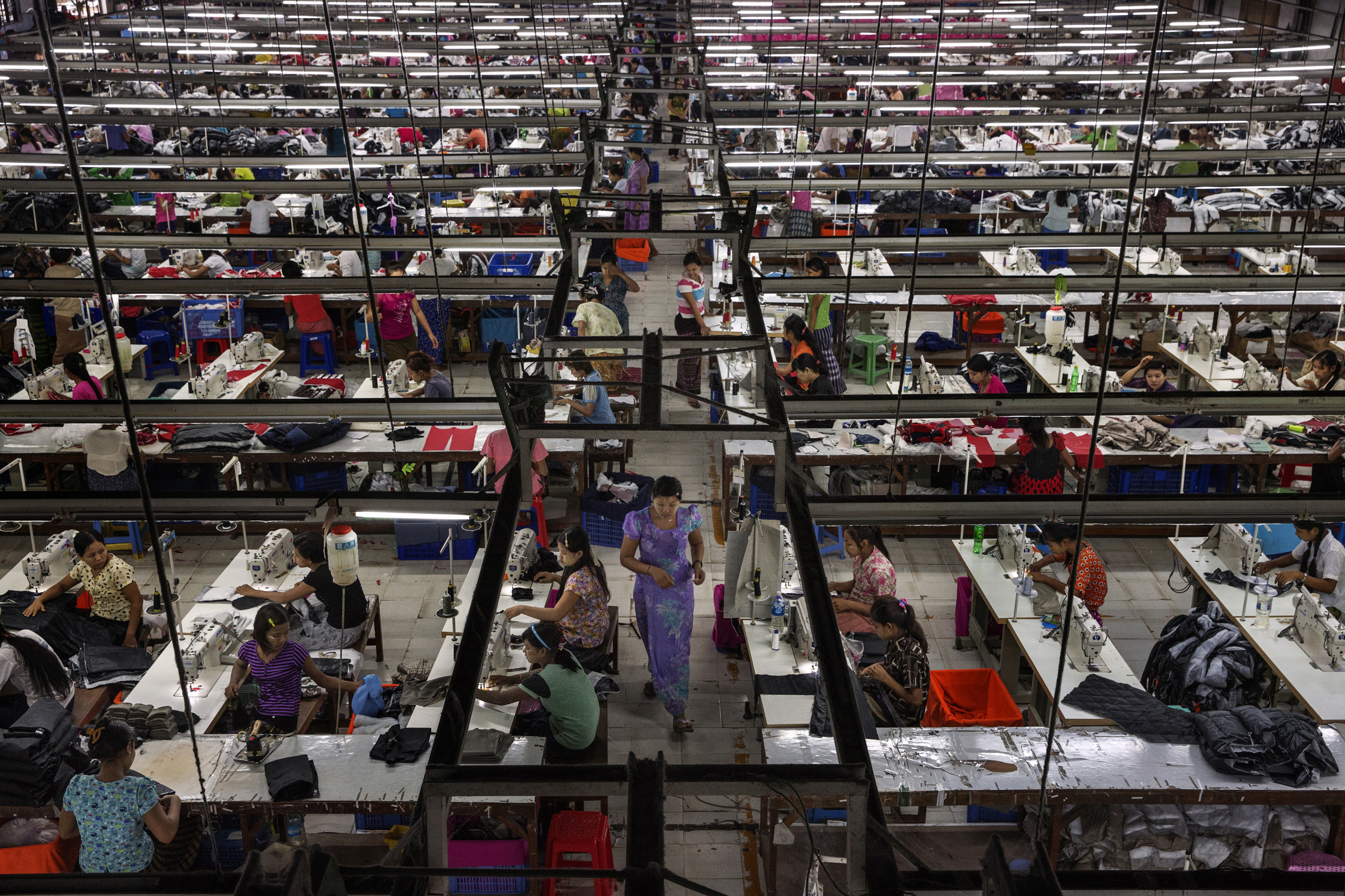 Workers make clothes for export  at a factory in Yangon, Burma, Sept. 18, 2014.