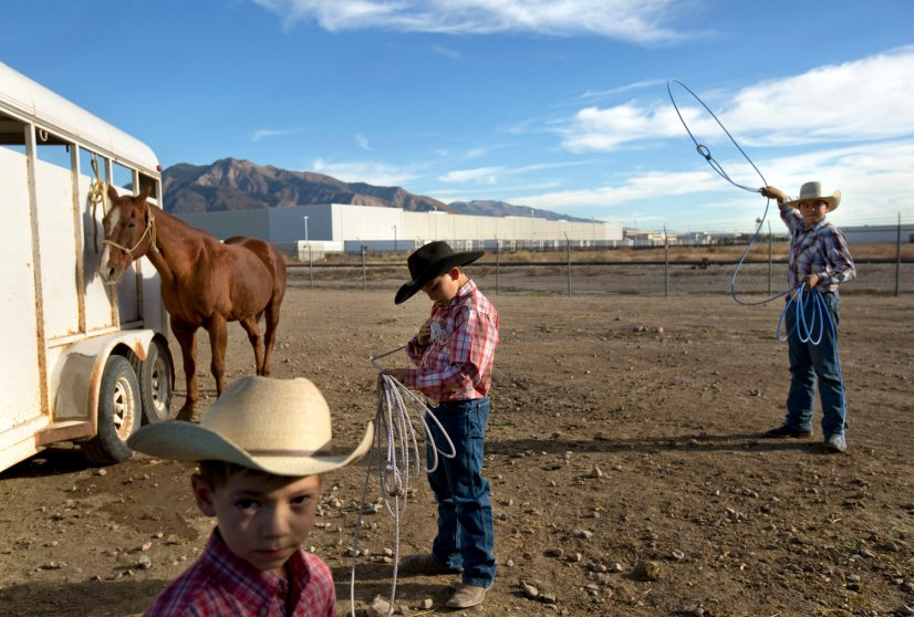 Youth rodeo, a nine-month-a-year sport, is as much of a way of life in Ogden, Utah, as it is an extracurricular activity. Here, from left, brothers Ridge, 5, Rustry, 11, and Jager Rinderknecht, 13, practiced in the parking lot before a competition, Oct. 14, 2014.